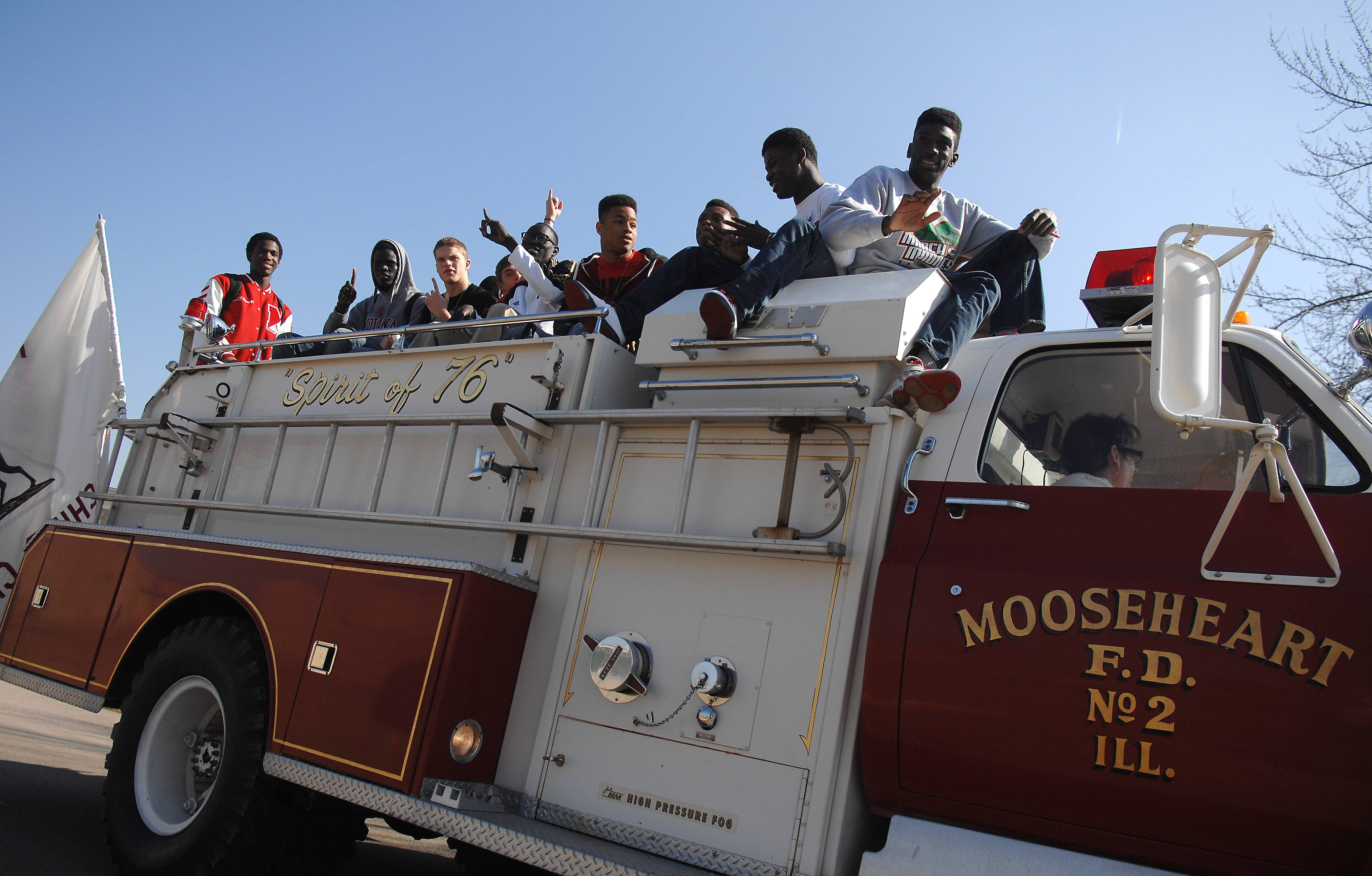 The Mooseheart Class 1A state champion basketball team gets a ride to lunch on a fire truck after being honored at a ceremony Friday at the school.