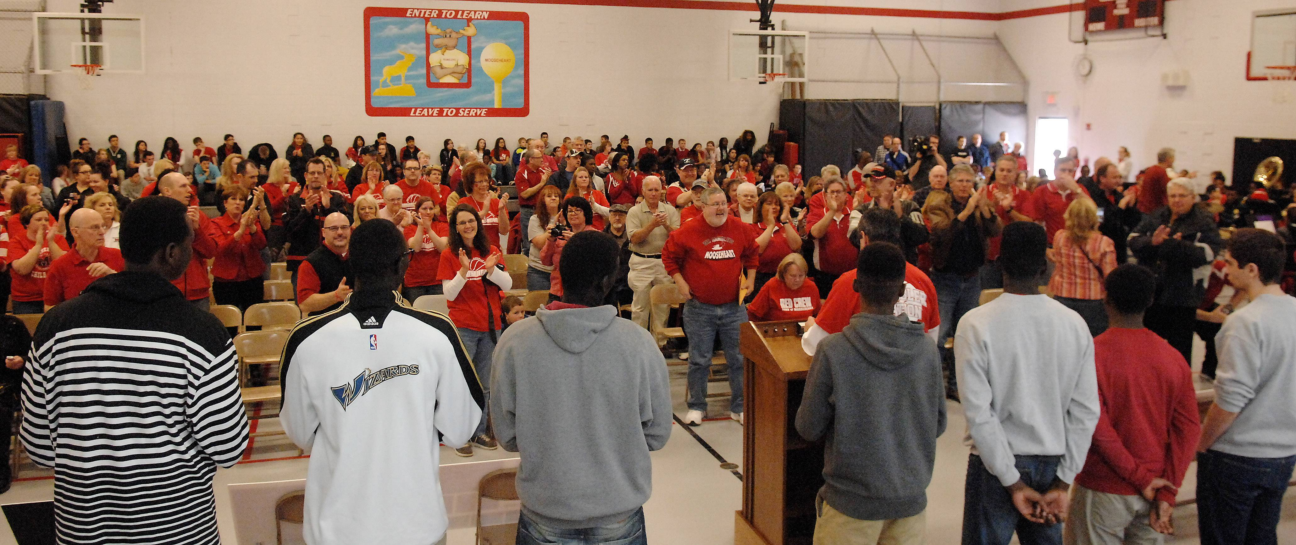 The Class 1A state champion basketball team gets a standing ovation during a ceremony for state qualifying athletes in fall and winter sports Friday at Mooseheart.