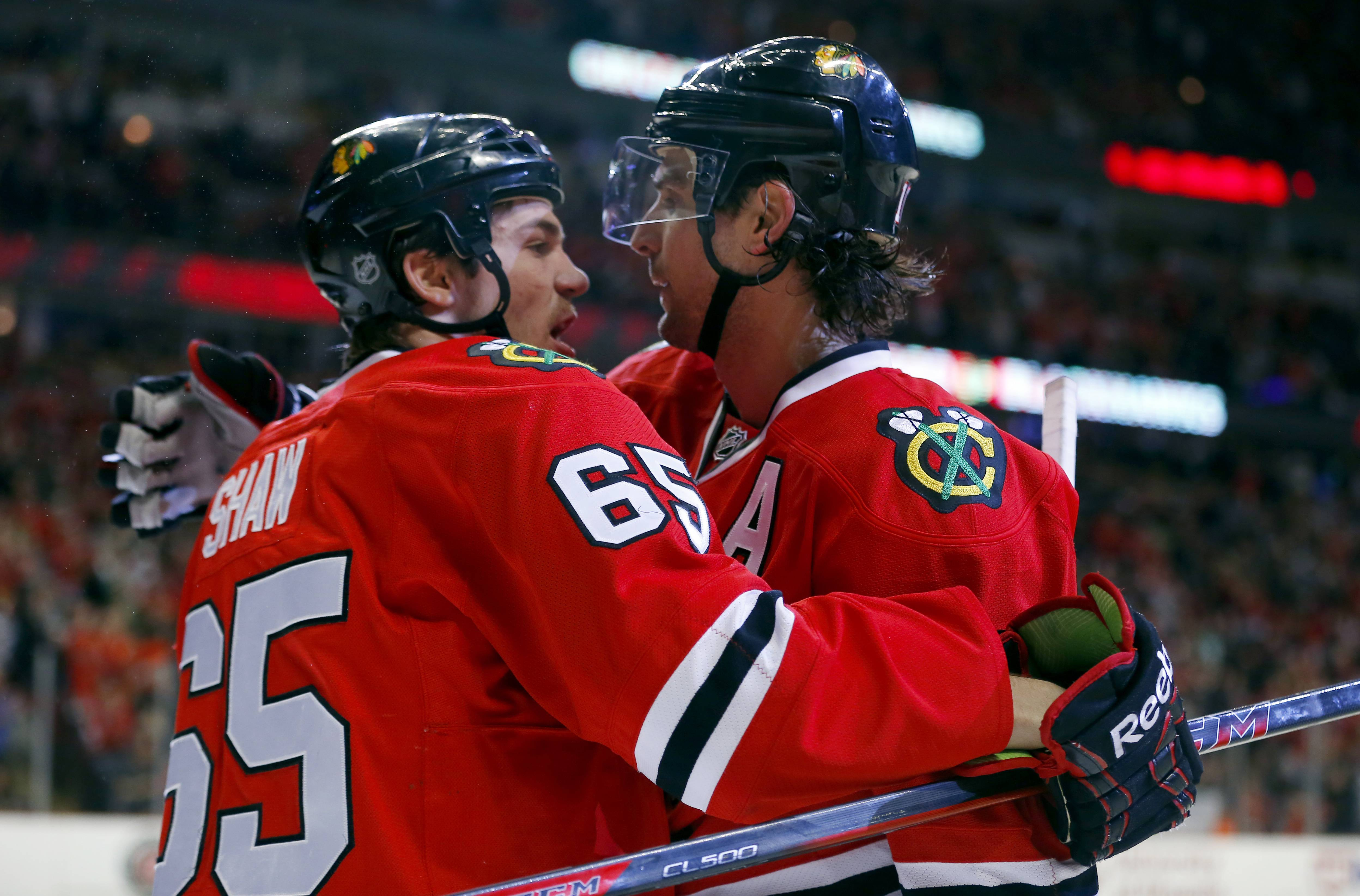 Andrew Shaw celebrates with Patrick Sharp after Sharp's goal in Friday's 3-2 victory over Carolina at the United Center.