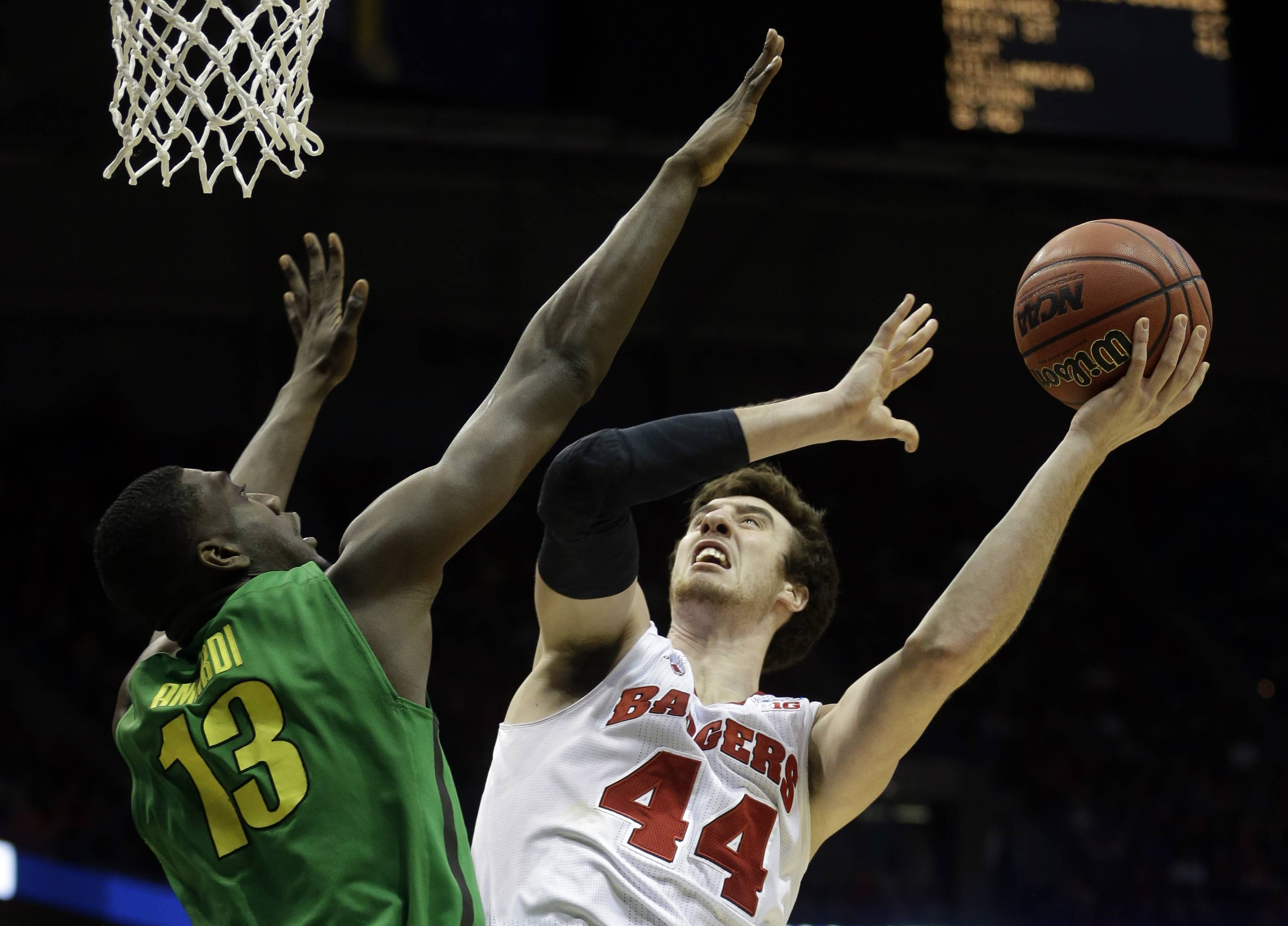 Wisconsin forward Frank Kaminsky (44) takes a shot against Oregon forward Richard Amardi (13) during a third-round game of the NCAA college basketball tournament Saturday in Milwaukee.
