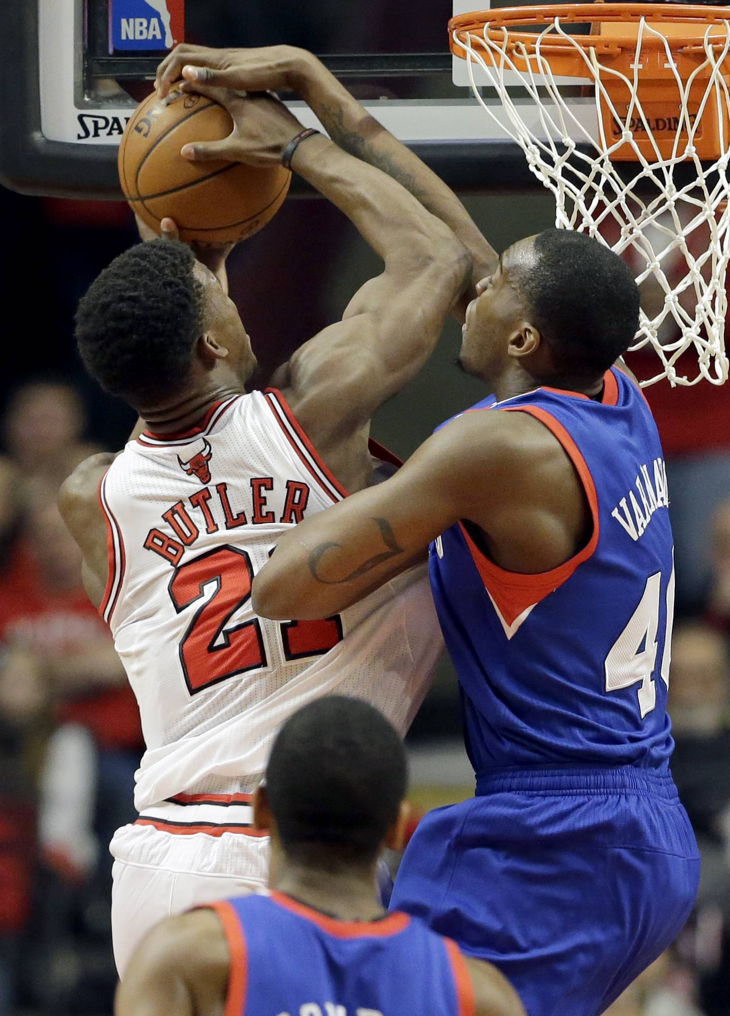 Philadelphia 76ers forward Jarvis Varnado (40), right, blocks a shot by Chicago Bulls guard Jimmy Butler (21) during Saturday night's game at the United Center.