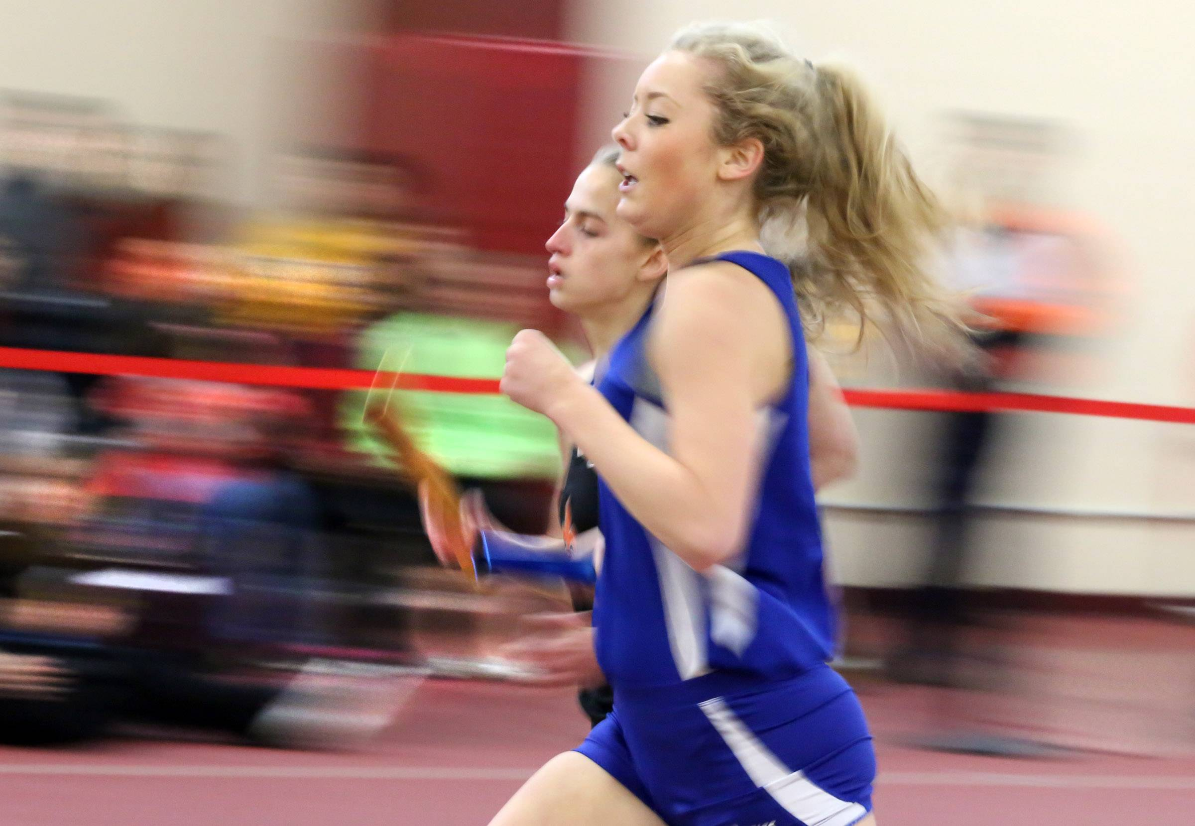 St. Charles North Sydney Brellenthin runs the first leg of 4 x 800 meter relay final in an Upstate Eight Conference indoor track meet on Saturday at Batavia.