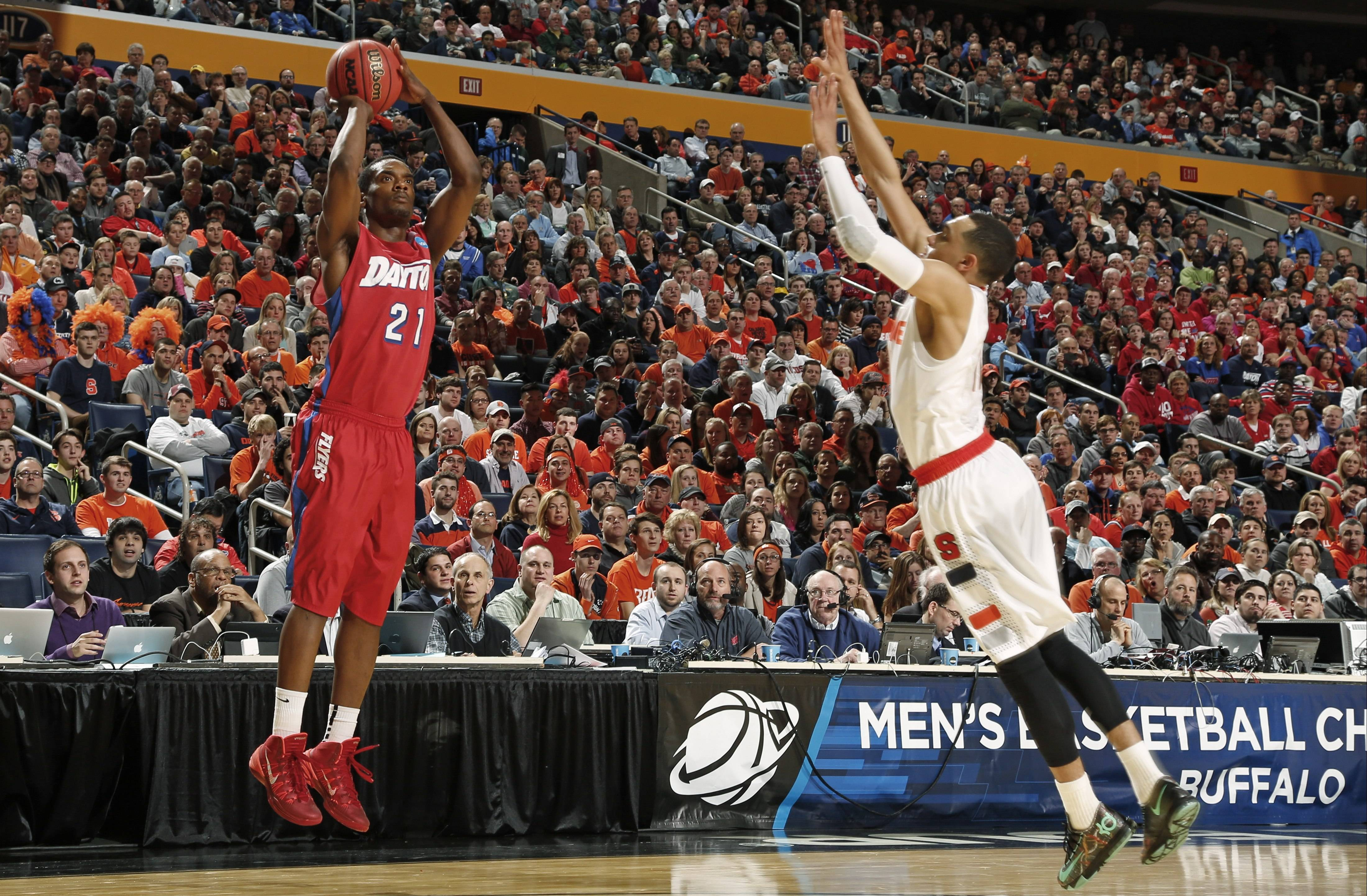 Dayton's Dyshawn Pierre (21) shoots over Syracuse's Tyler Ennis (11) during a third-round game in the NCAA men's college basketball tournament Saturday in Buffalo, N.Y. Pierre scored 14 points in Dayton's upset win over Syracuse.
