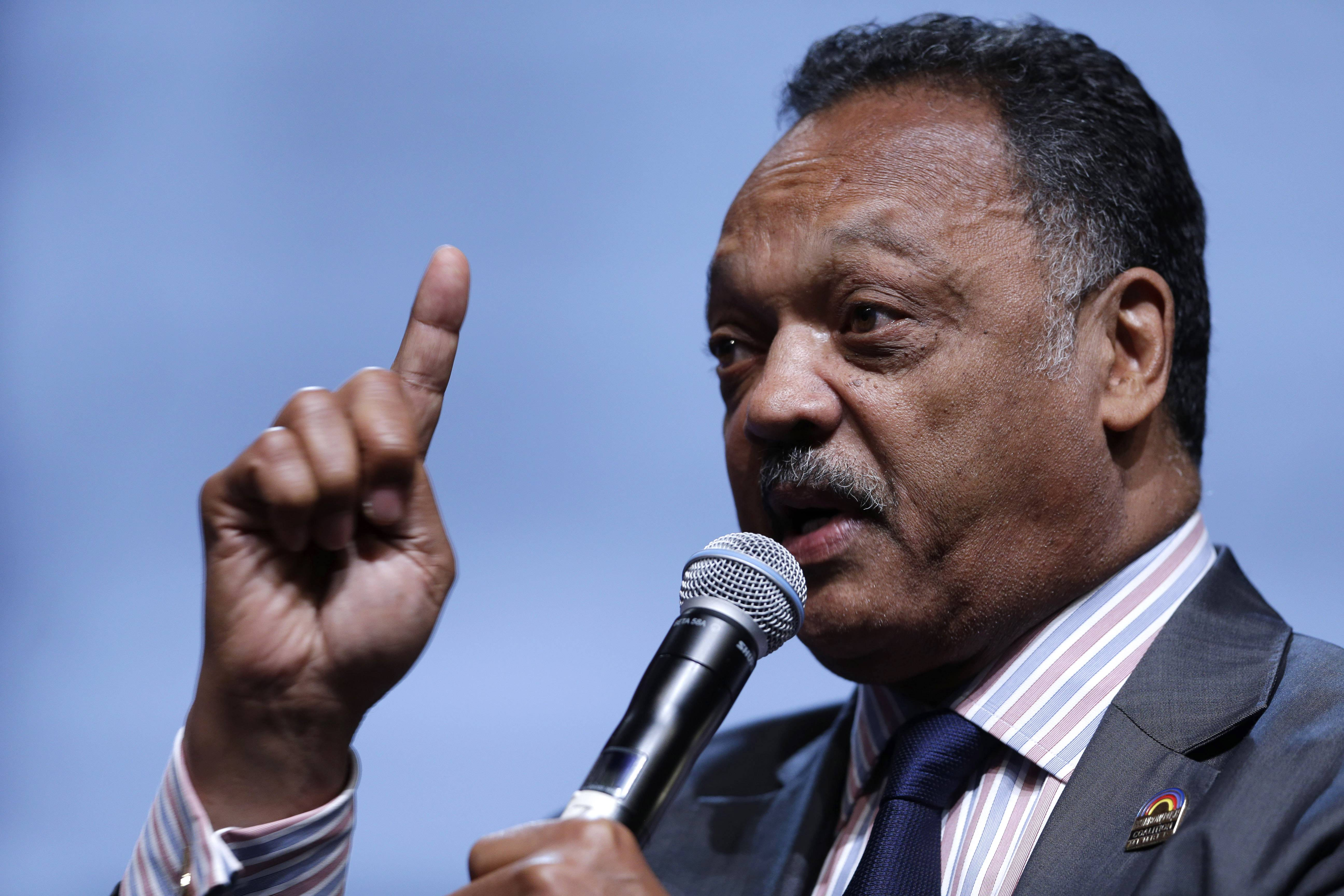 The Rev. Jesse Jackson speaks as he takes part in a panel discussion during the National Urban League's annual conference, in Philadelphia. Jackson is bringing attention to Silicon Valley's poor record of including blacks and Latinos in hiring, board appointments and startup funding.