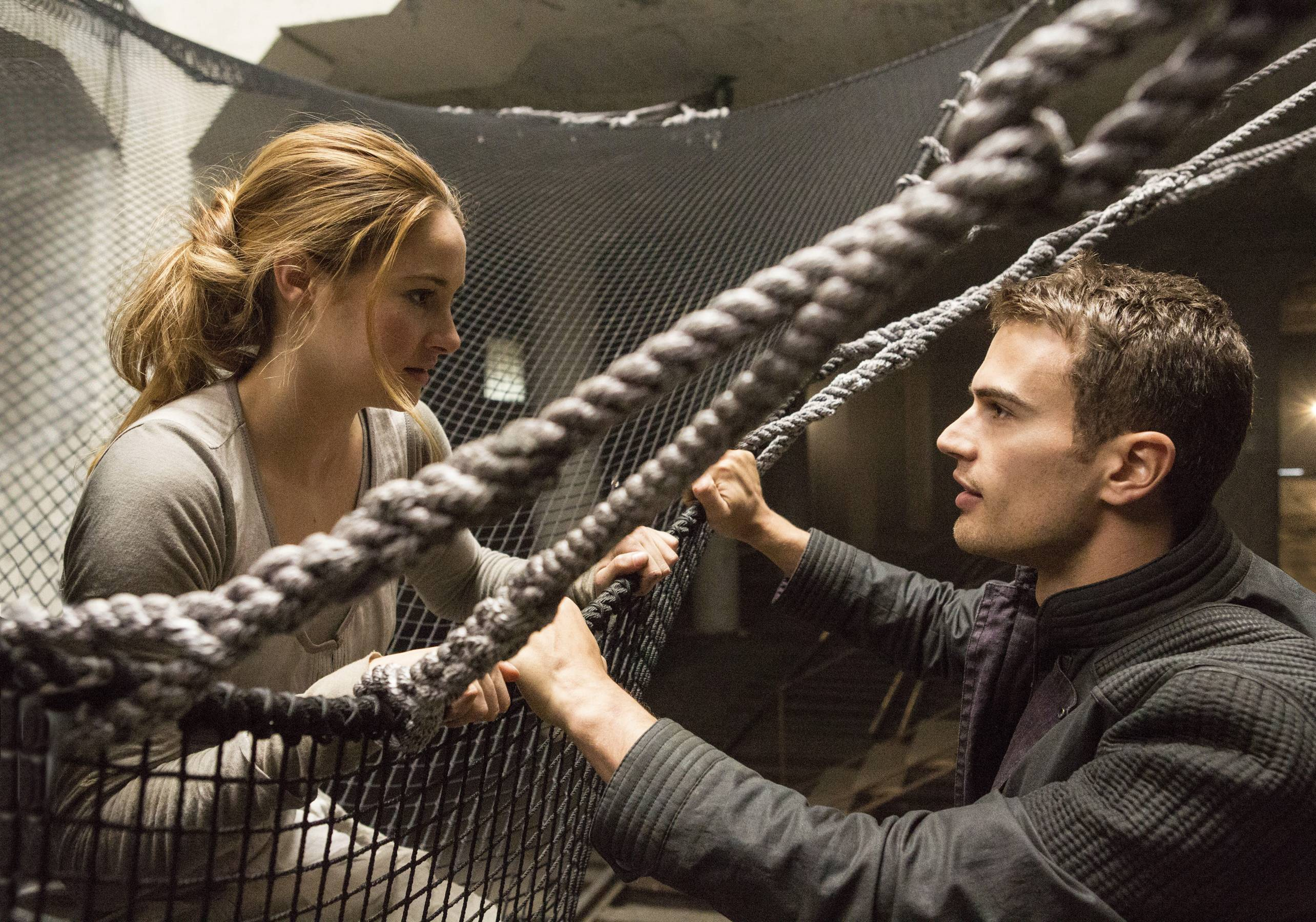 "This image released by Summit Entertainment shows Shailene Woodley, left, and Theo James in a scene from ""Divergent."" The movie, which is based on Barrington native Veronica Roth's best-selling novels, raked in $56 million at the box office in its first weekend of release."