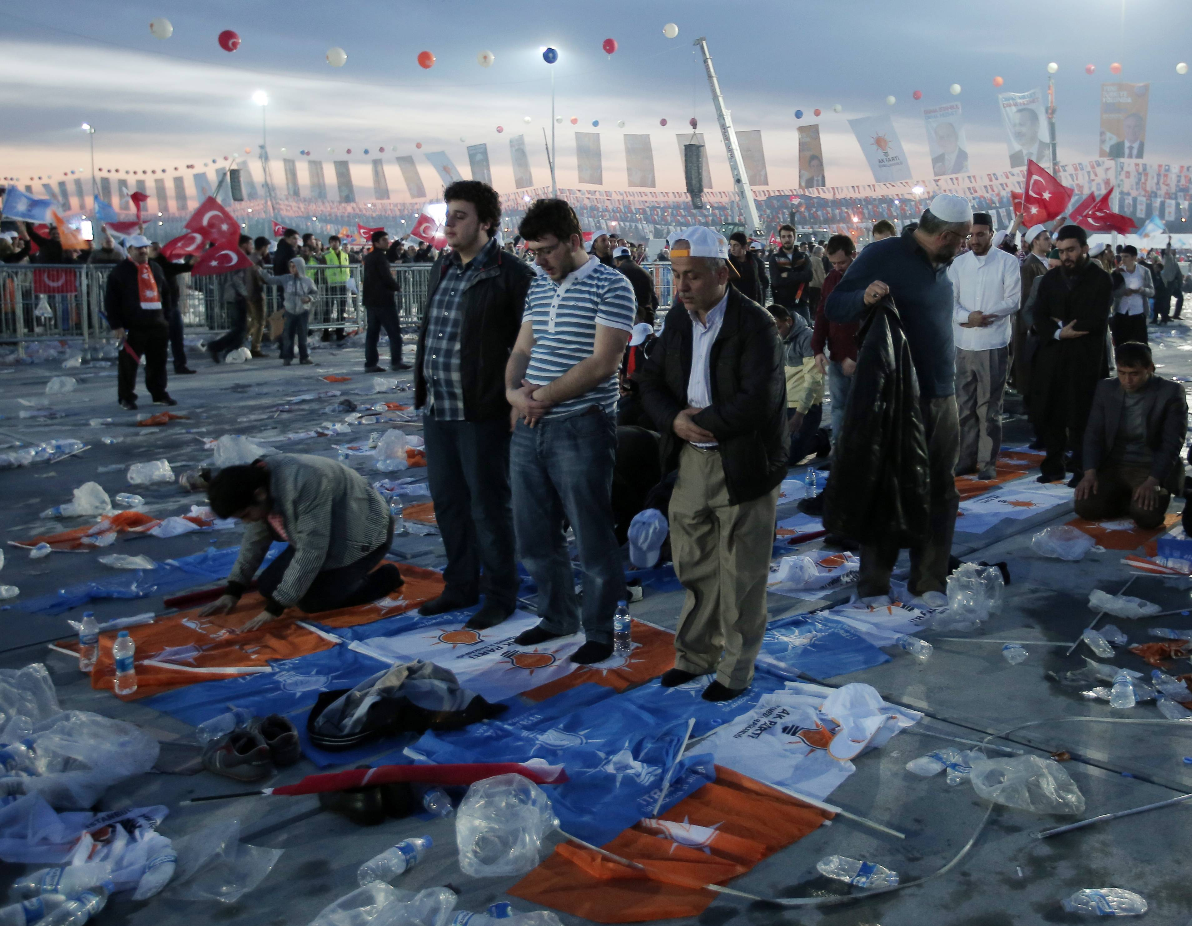 The supporters of Turkish Prime Minister Recep Tayyip Erdogan pray after a rally of his Justice and Development Party in Istanbul, Turkey, Sunday. Turkish fighter jets shot down a Syrian warplane after it violated Turkey's airspace Sunday, Erdogan said, in a move likely to ramp up tensions between the two countries already deeply at odds over Syria's civil war.