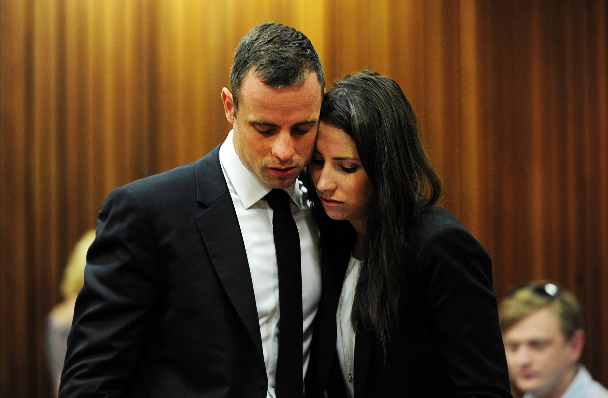 Oscar Pistorius hugs his sister Aimee, right, in court in Pretoria, South Africa, last week. Pistorius is on trial for the murder of his girlfriend Reeva Steenkamp on Valentine's Day in 2013.