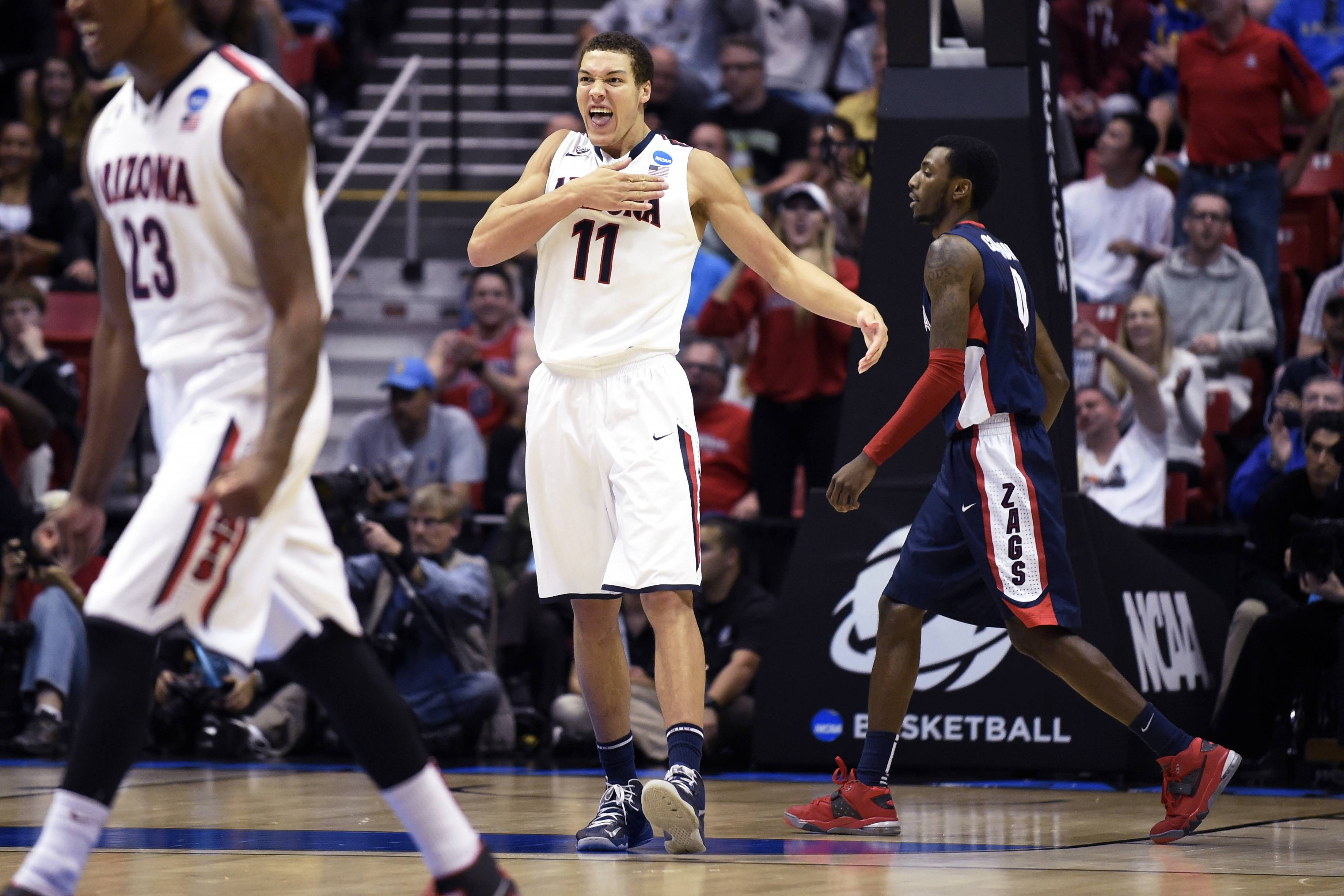 Arizona forward Aaron Gordon (11) beats his chest after scoring a basket as Gonzaga guard Gerard Coleman, right, walks towards the bench during the first half of a third-round game in the NCAA college basketball tournament Sunday, March 23, 2014, in San Diego.