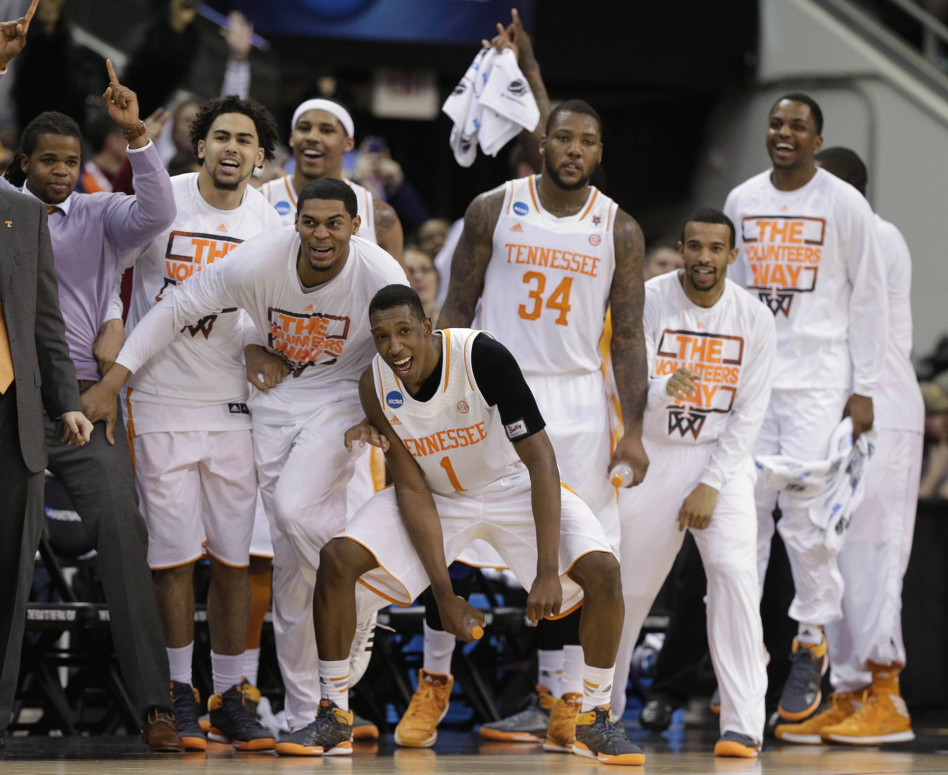 Tennessee players celebrate near the end of the second half of an NCAA college basketball third-round tournament game against Mercer, Sunday, March 23, 2014, in Raleigh. Tennessee Won 83-63.