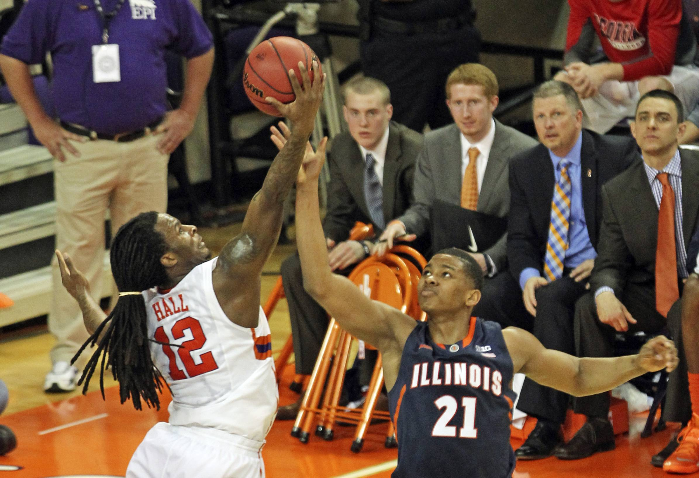 Clemson's Rod Hall, left, steals the ball from Illinois' Malcolm Hill during the second half of an NCAA college basketball National Invitational Tournament game in Clemson, S.C., on Sunday, March 23, 2014.