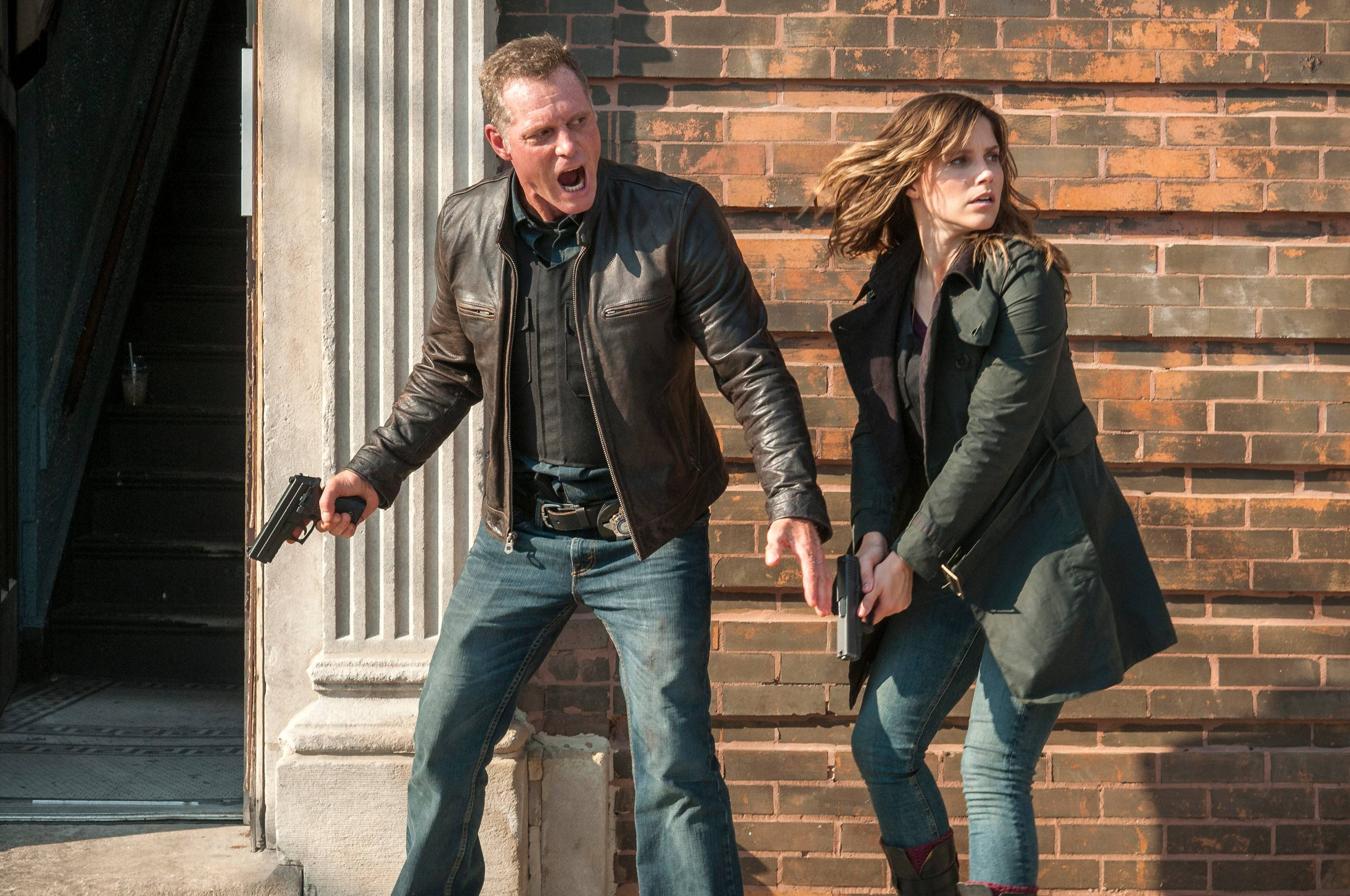 "Jason Beghe as Detective Sgt. Hank Voight, left, and Sophia Bush as Erin Lindsay appears in a scene from ""Chicago P.D."" Centered on the Chicago Police Department's scrappy Intelligence Unit, the series by Dick Wolf pits Voight and his team against the worst killers, drug traffickers and mobsters the Windy City can deliver."