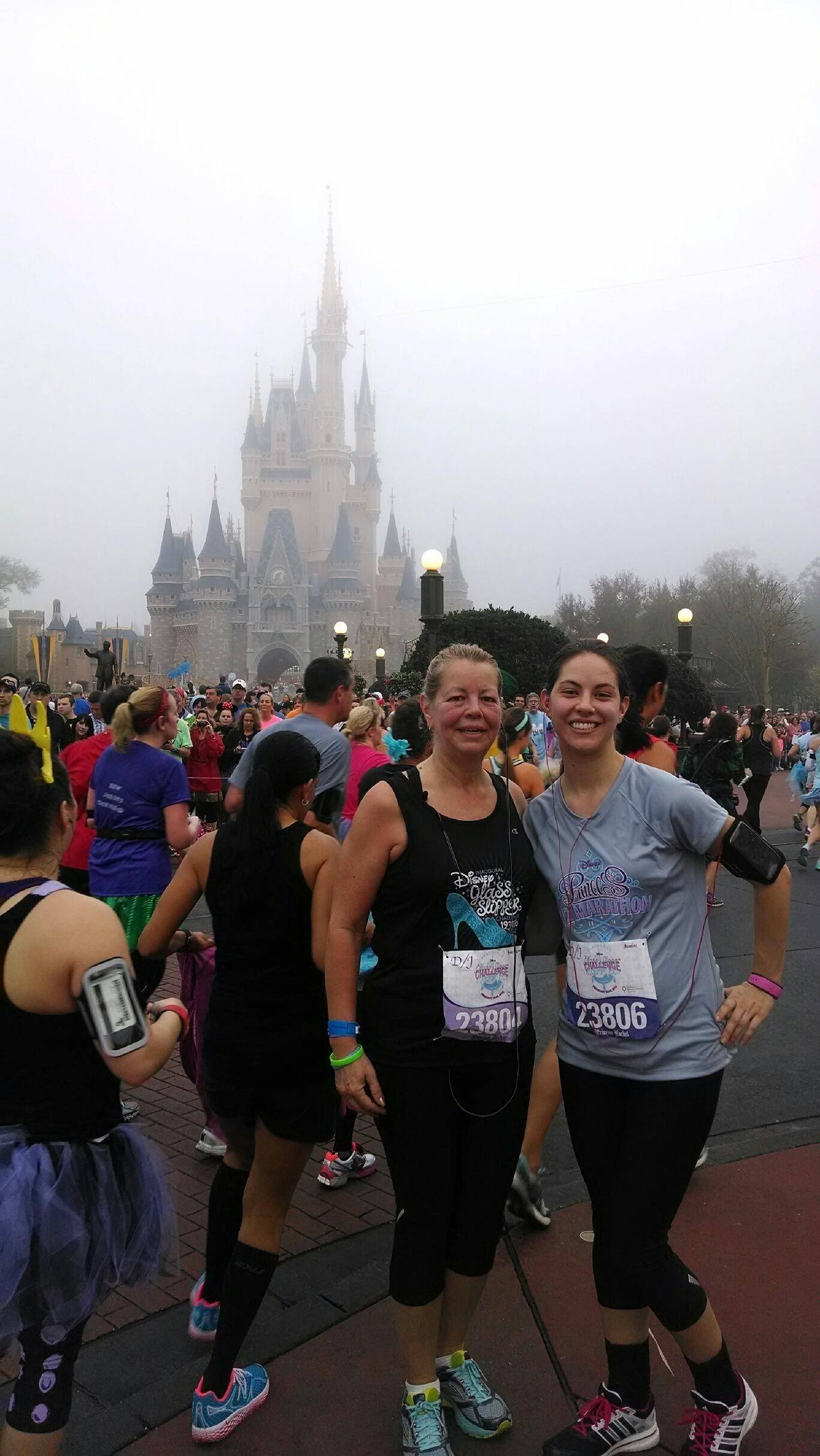 Aurora residents Jackie Horvath and daughter Rachel pose in front of the Magic Kingdom's Cinderella Castle during the Princess Half Marathon last month at Walt Disney World in Florida.