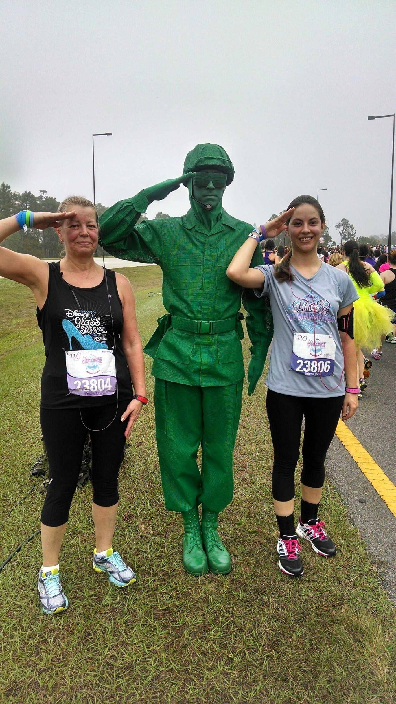 "Aurora residents Jackie Horvath and her daughter, Rachel, pose with a living plastic soldier from ""Toy Story"" during the Princess Half Marathon on Feb. 23 at Walt Disney World in Lake Buena Vista, Fla."