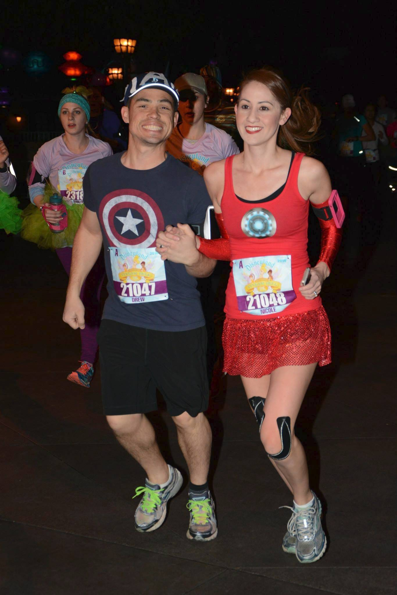 This couple running in superhero gear during the Disneyland Tinkerbell 10K in January might want to reuse their outfits for the new Disneyland Avengers Super Heroes Half Marathon.