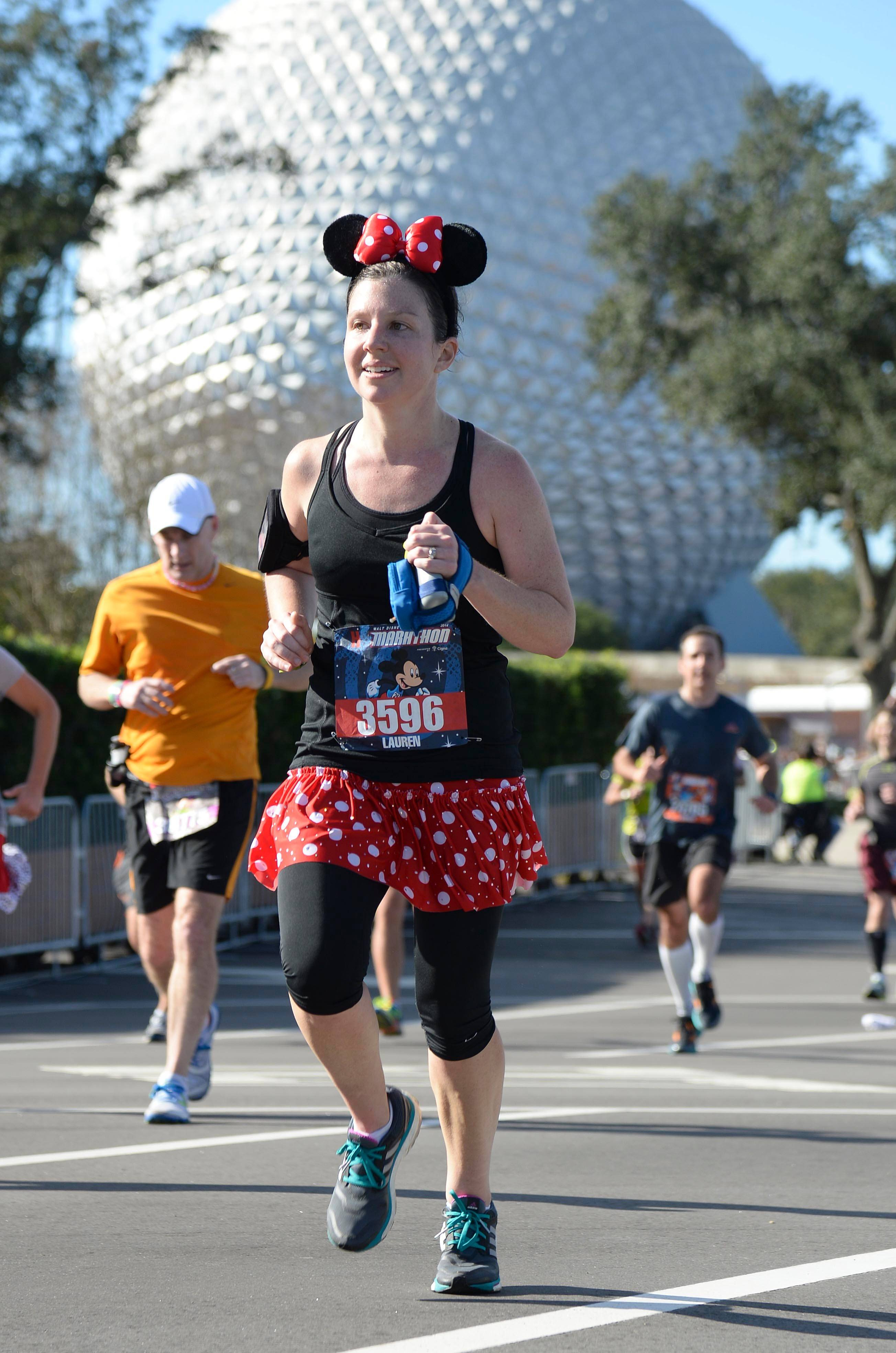Runners race through Epcot during the 2014 Walt Disney World Marathon. The annual event takes athletes through all four Walt Disney World theme parks in Lake Buena Vista, Fla. Runners from 50 states and 60 countries participated in the weekend events presented by runDisney.