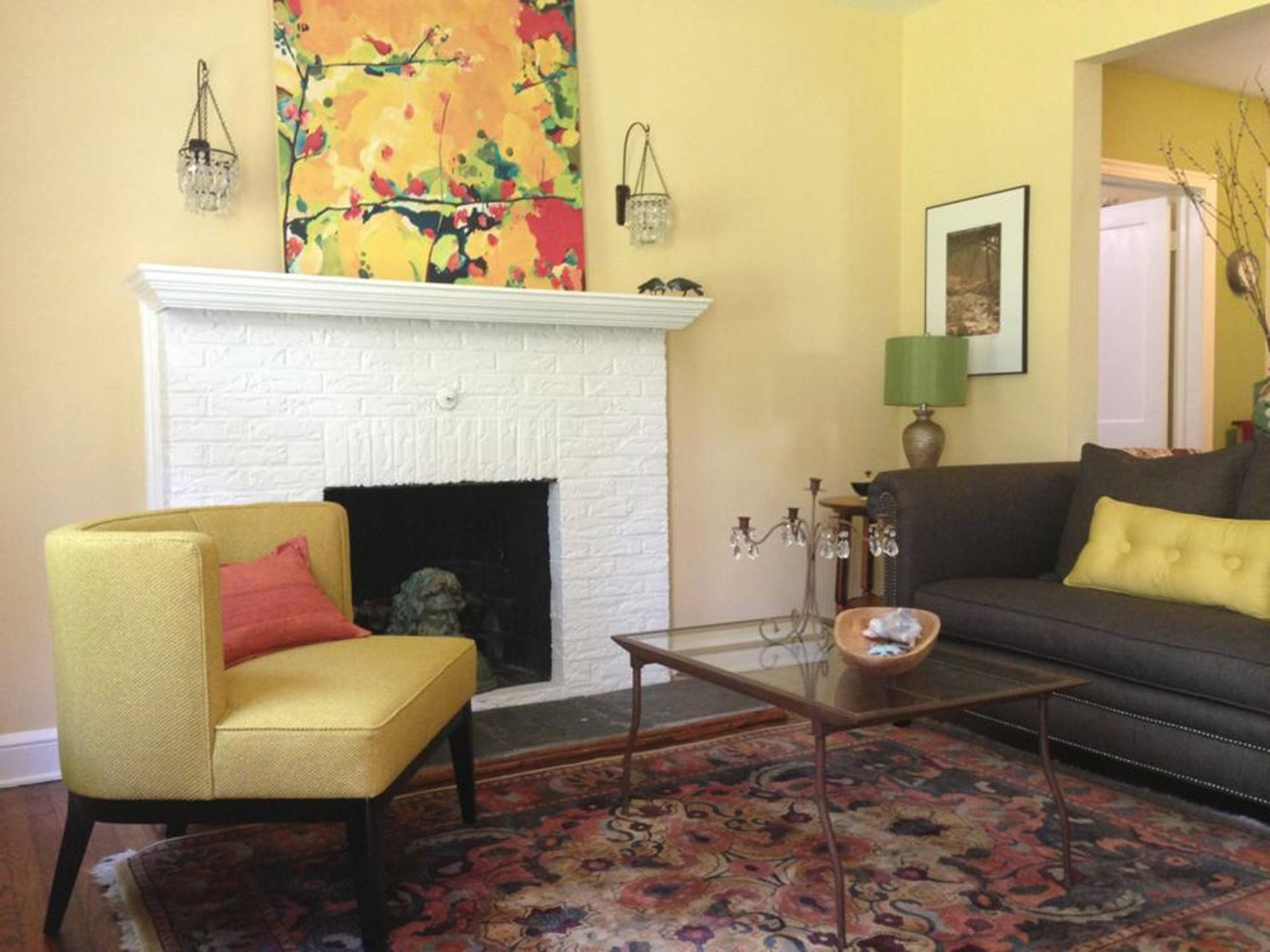 This living room was painted in Benjamin Moore's Straw, a choice by Colors by Zoe, a Takoma Park, Md., paint consulting business.