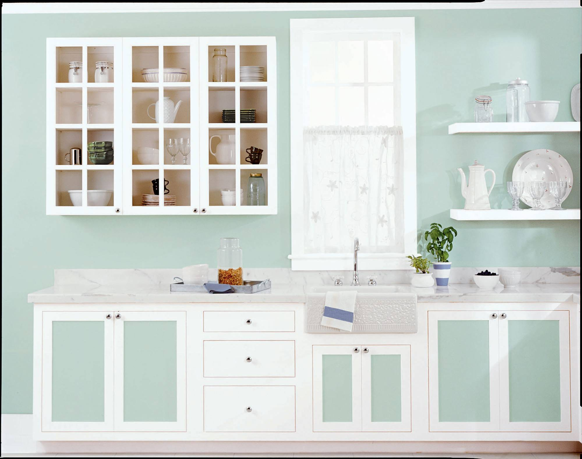 This crisply painted kitchen features Behr's Valley Mist and Ultra Pure White. People typically try three to five paint colors before deciding on their final selection.