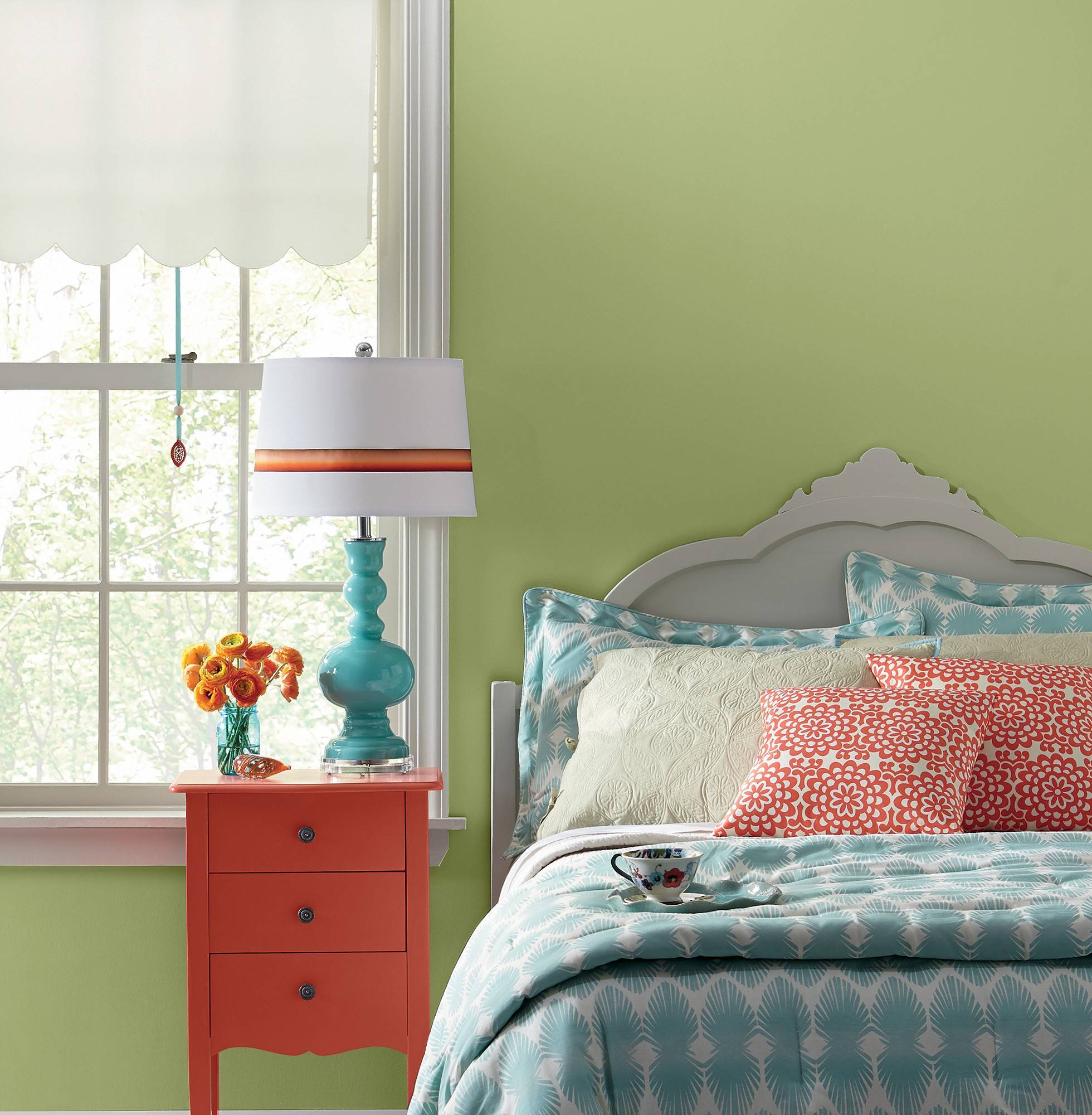 A cheerful bedroom is painted in Valspar's Leaf Bud.