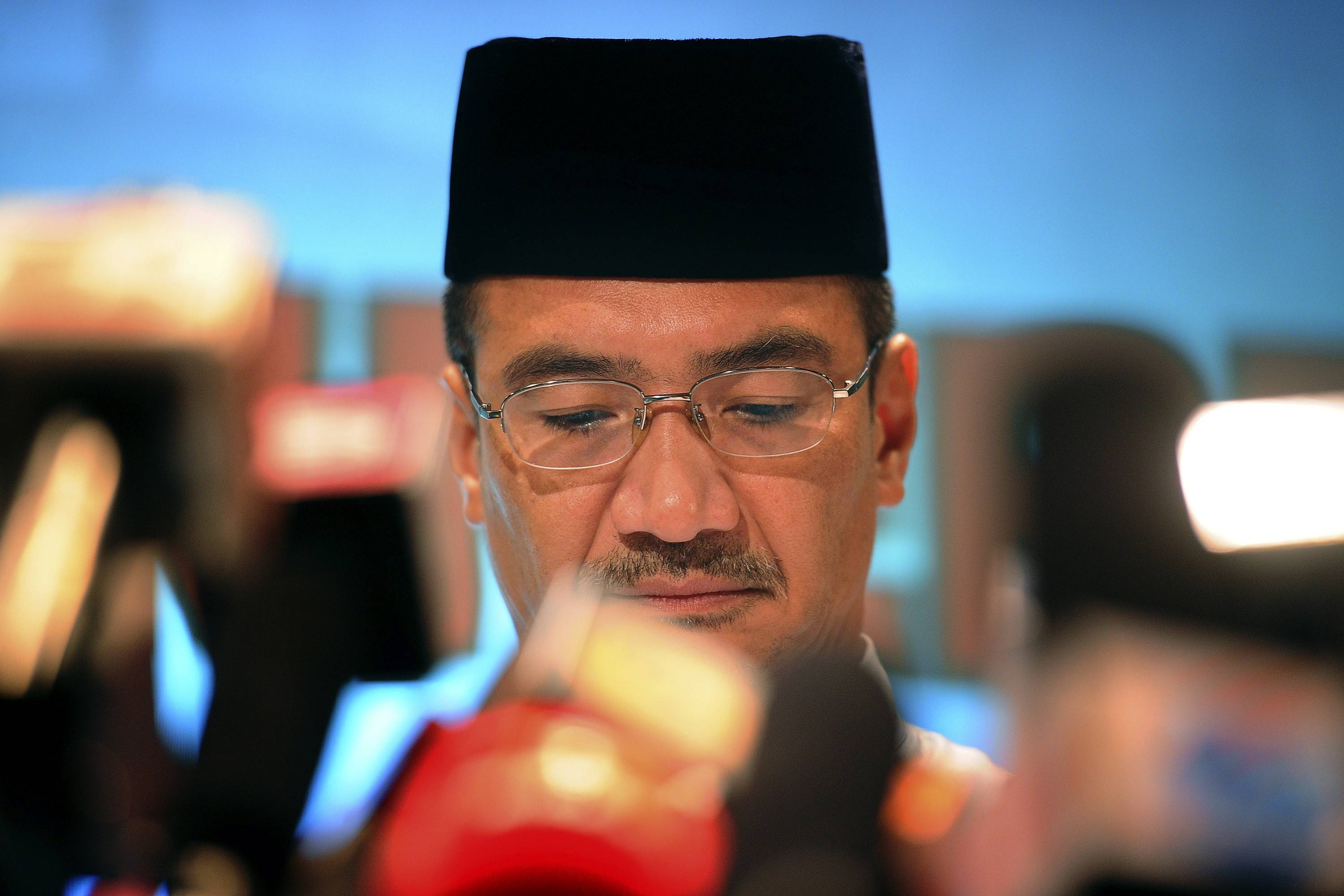 Malaysia's acting Transport Minister Hishammuddin Hussein pauses in between questions during a news conference for the missing Malaysia Airline plane Friday near Kuala Lumpur, Malaysia. Nobody knows if the pilots are heroes who tried to save a crippled airliner or if one collaborated with hijackers or was on a suicide mission.