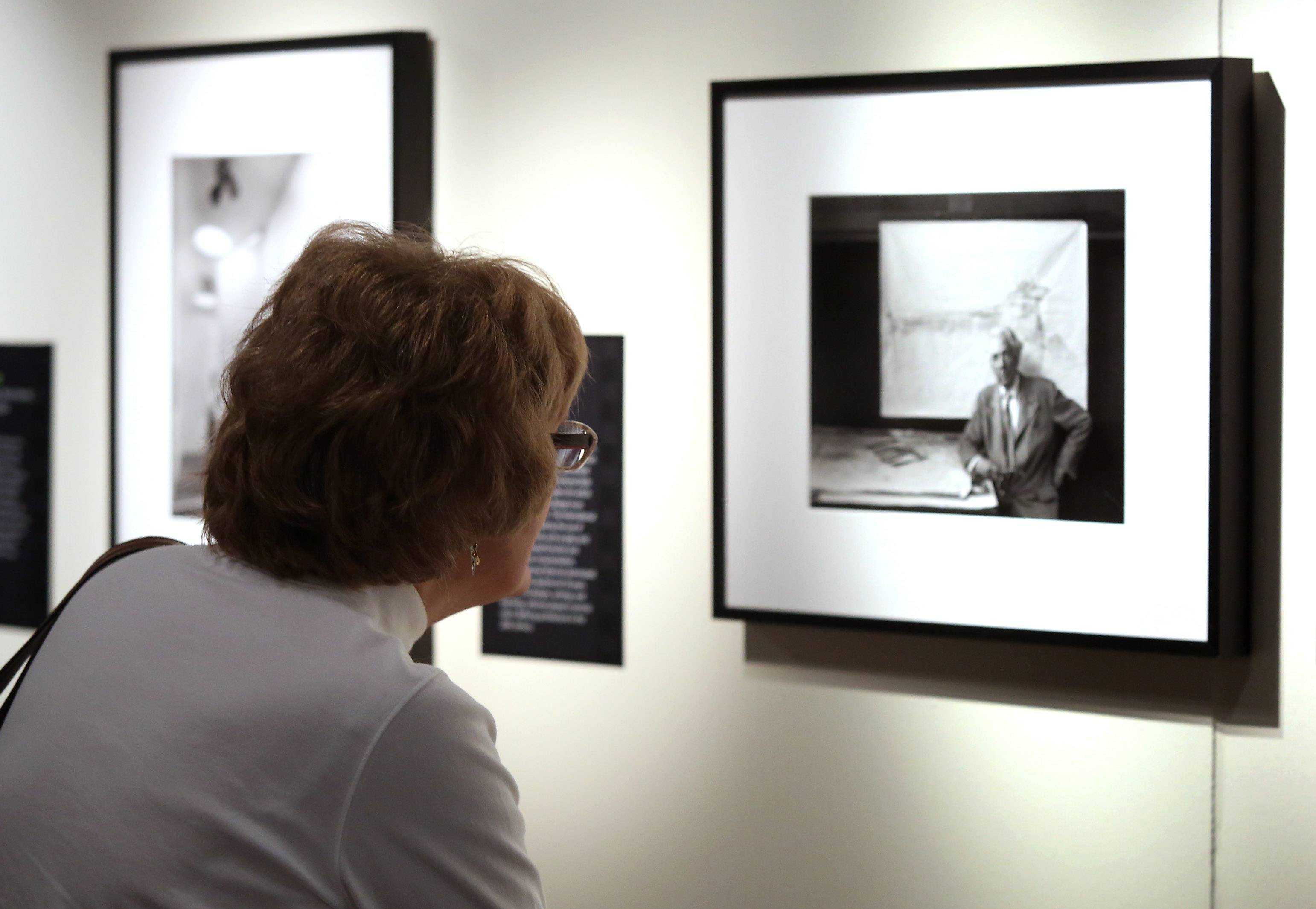 Kathy Maynard of Deerfield looks at a portrait of Frank Lloyd Wright during a tour of the photographic show of Arnold Newman Sunday at the Lake County Discovery Museum near Wauconda.