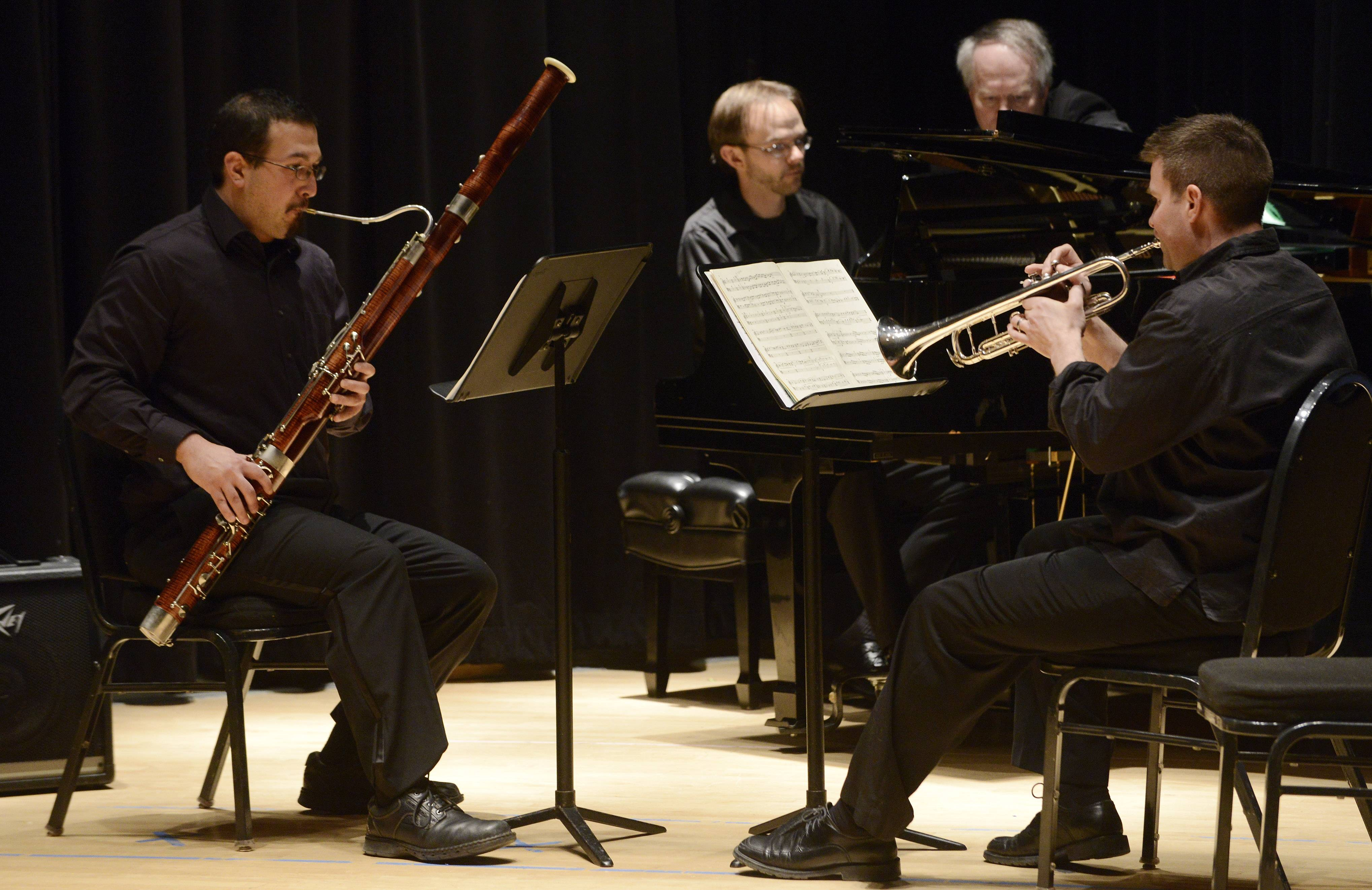 "Ricardo Vasquez on bassoon, Jason Flaks on trumpet, and David Anderson at the piano perform ""Concerto for Trumpet and Bassoon Allegro spiritoso"" by Paul Hindemith at Sunday's Elgin Youth Symphony Orchestra Faculty Benefit Recital at Elgin Community College."
