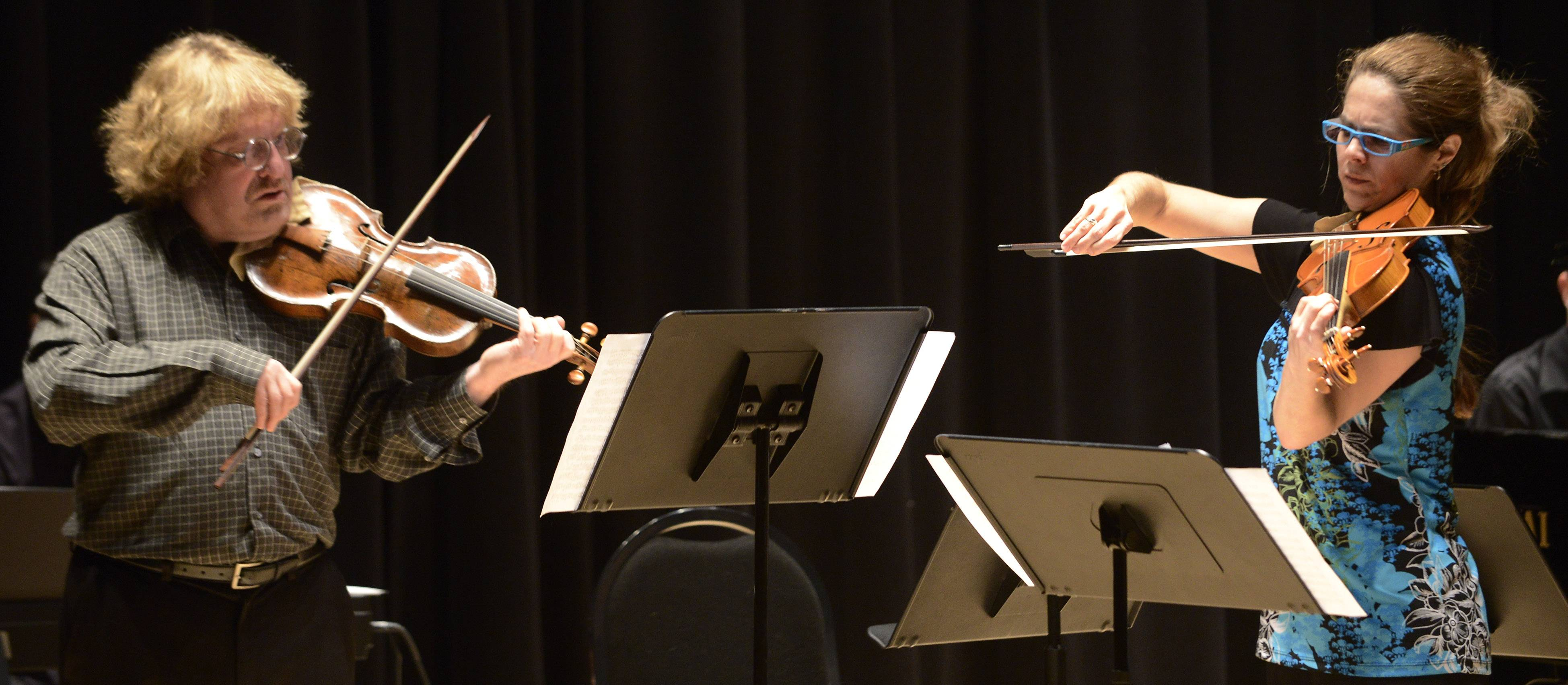 Danny Seidenberg, left, and Daryl Silberman on Baroque violins perform Sunday at the Elgin Youth Symphony Orchestra Faculty Benefit Recital. The EYSO faculty and Chamber Music Institute coaches performed together.