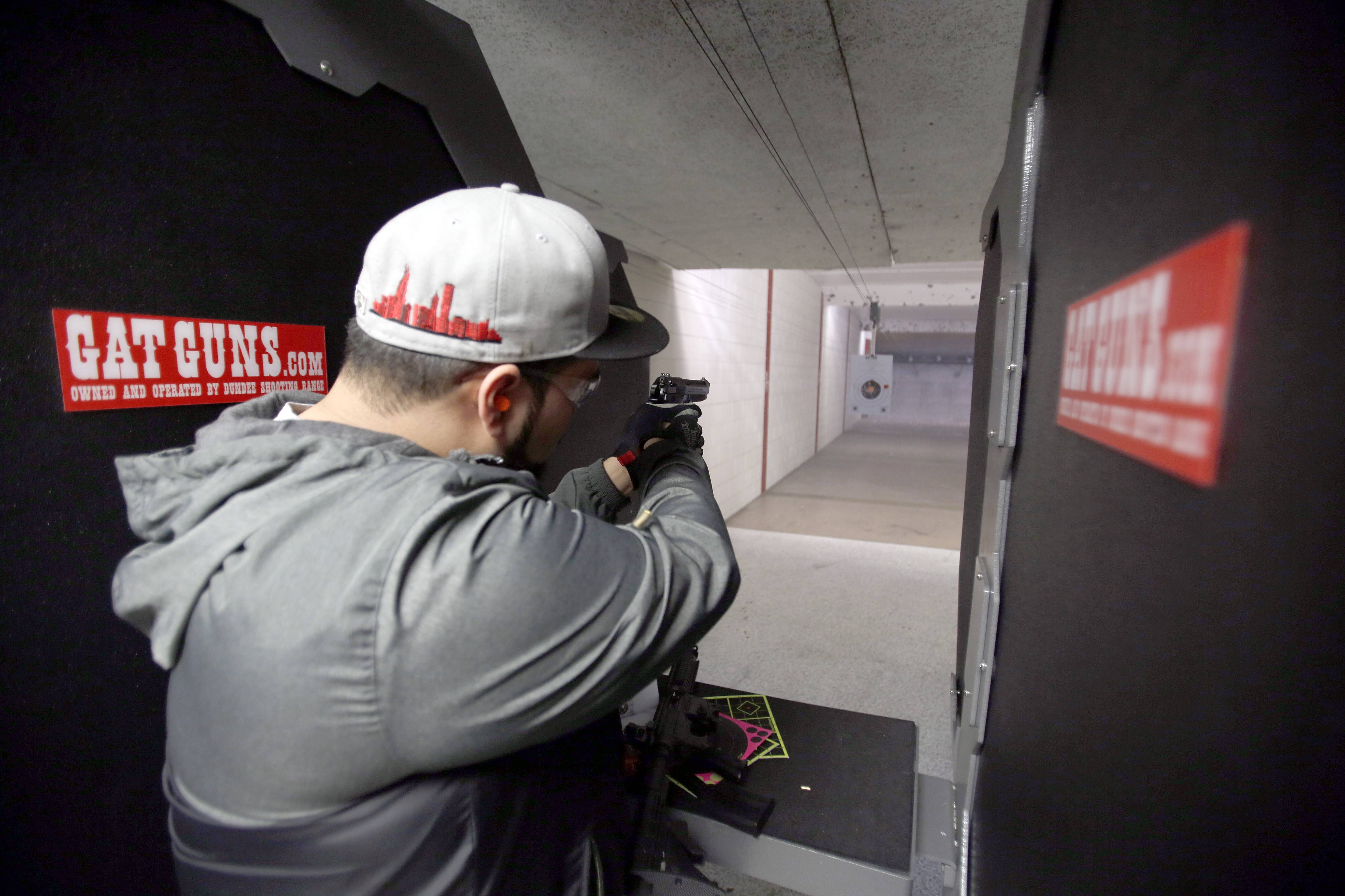 Jaime Olivas, 24, of Bellwood, practices at the range at GAT Guns in East Dundee. Local ranges have seen a significant increase in usage after Illinois passed a concealed carry law last July.
