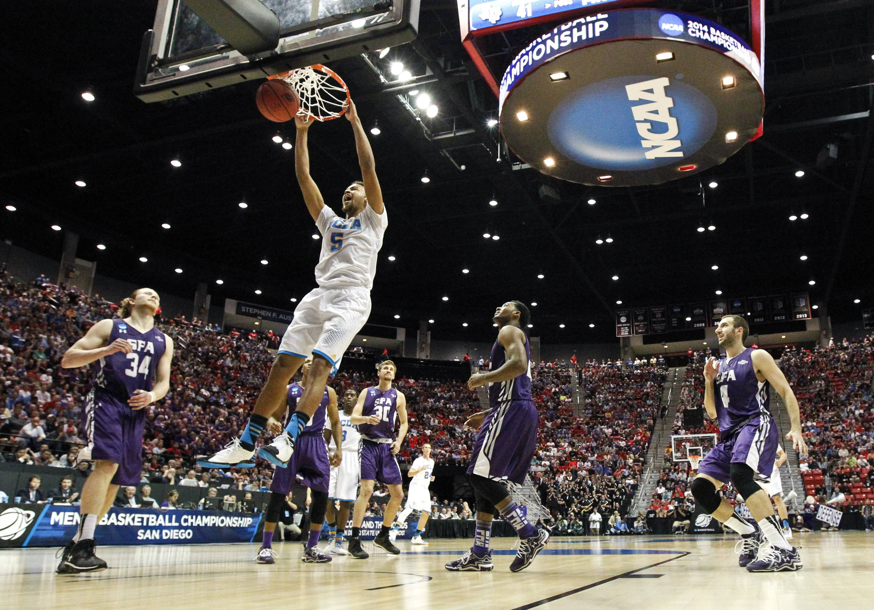 UCLA guard Kyle Anderson slams home a dunk as UCLA pulls away from Stephen F. Austin during the second half of a third-round game in the NCAA college basketball tournament, Sunday, March 23, 2014, in San Diego.