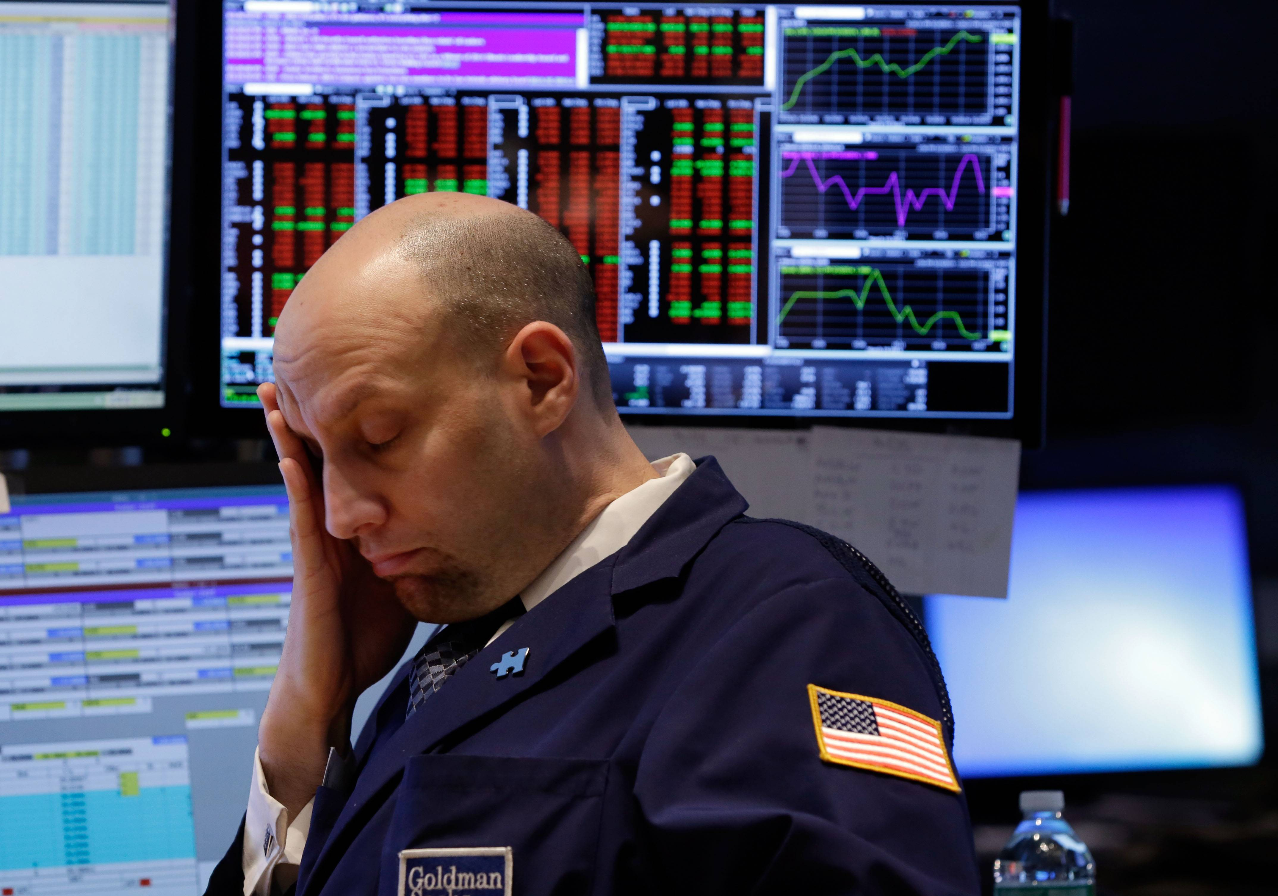 U.S. stocks fell for a second day Monday as economic data signaled a slowdown in American manufacturing and some banks said Russia's economy will enter a recession.
