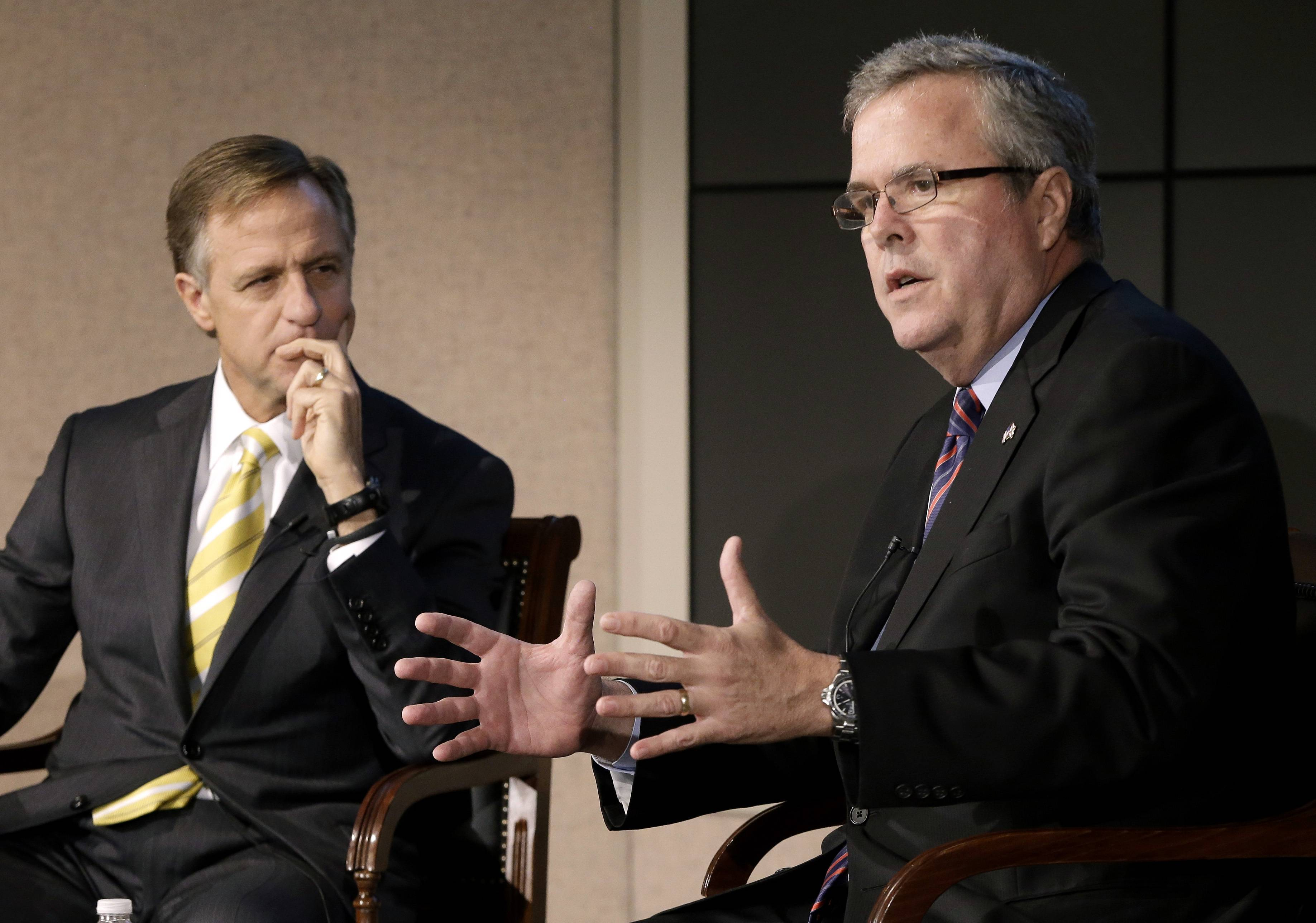 Former Florida Gov. Jeb Bush, right, and Tennessee Gov. Bill Haslam talk about education reform during a forum in Nashville, Tenn. More than five years after governors from both major parties began a mostly quiet effort to set new standards in American schools, the so-called Common Core initiative has morphed into a political tempest that fuels division among Republicans. Bush hails Common Core as a way to improve student performance and, over the long term, competitiveness of American workers.