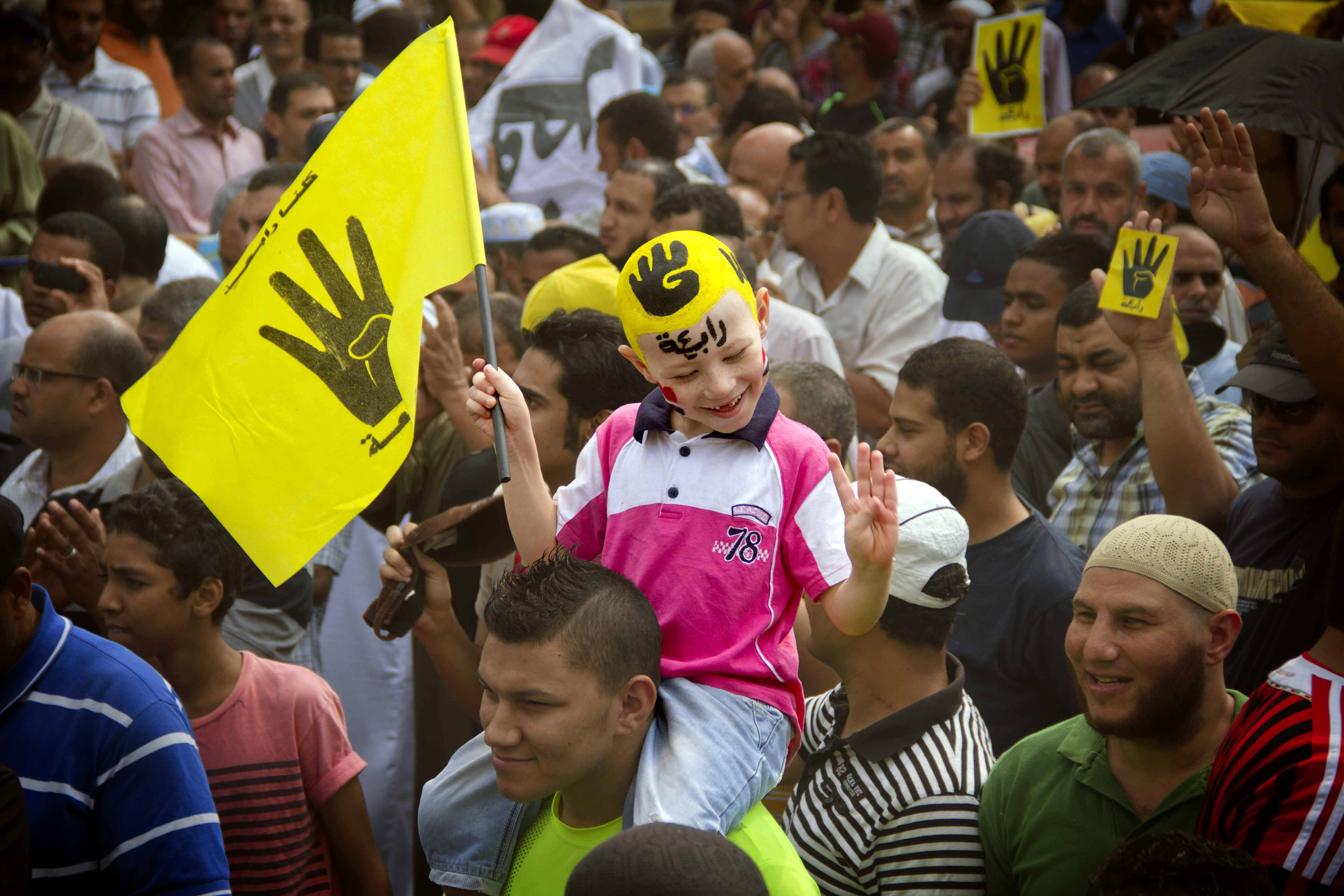 A young Egyptian boy participates in a demonstration by supporters of ousted President Mohammed Morsi in the Maadi district of Cairo, Egypt. A court in southern Egyptian has convicted nearly 530 supporters of ousted Islamist President Mohammed Morsi, sentencing them to death on charges of murdering a policeman and attacking police.