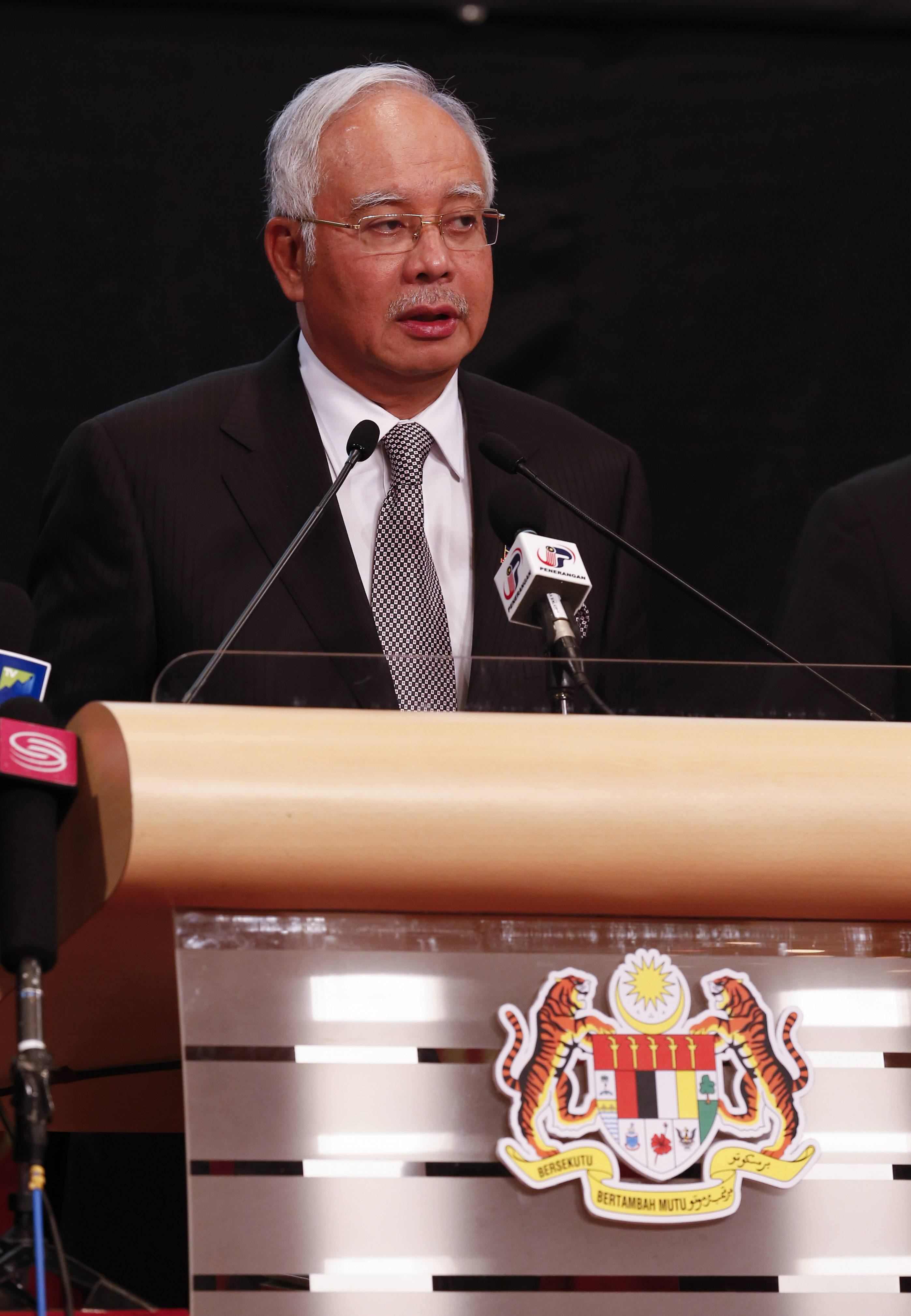 Malaysia's Prime Minister Najib Razak speaks Monday during the press conference for the missing Malaysia Airline, MH370 at Putra World Trade Centre (PWTC) in Kuala Lumpur, Malaysia. Razak says new data show missing plane plunged into southern Indian Ocean.