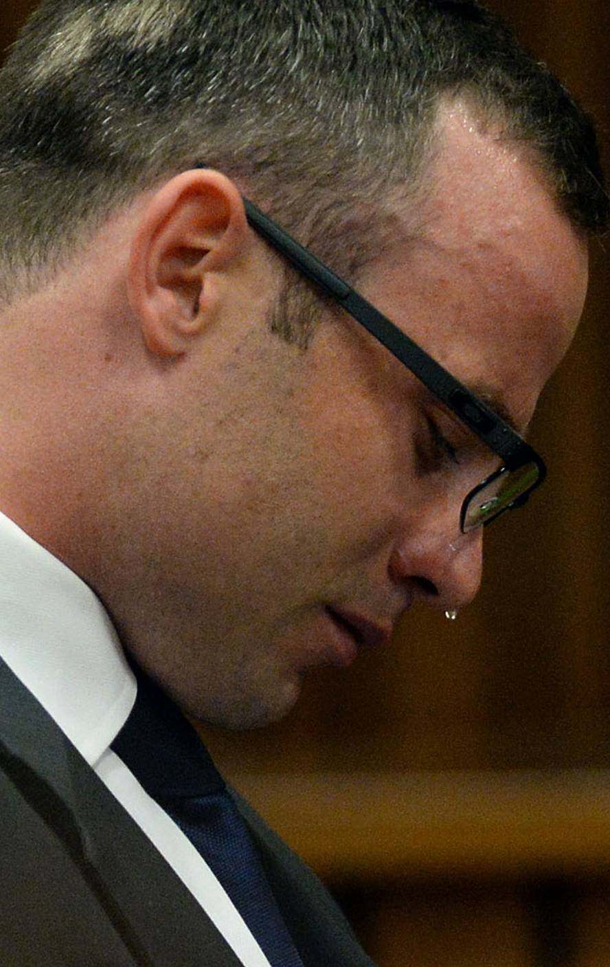 Oscar Pistorius, cries in court as he listens to evidence being given in Pretoria, South Africa, Monday, March 24, 2014. Pistorius is on trial for the shooting death of his girlfriend Reeva Steenkamp on Valentines Day 2013. (AP Photo/Chris Collingridge, Pool)