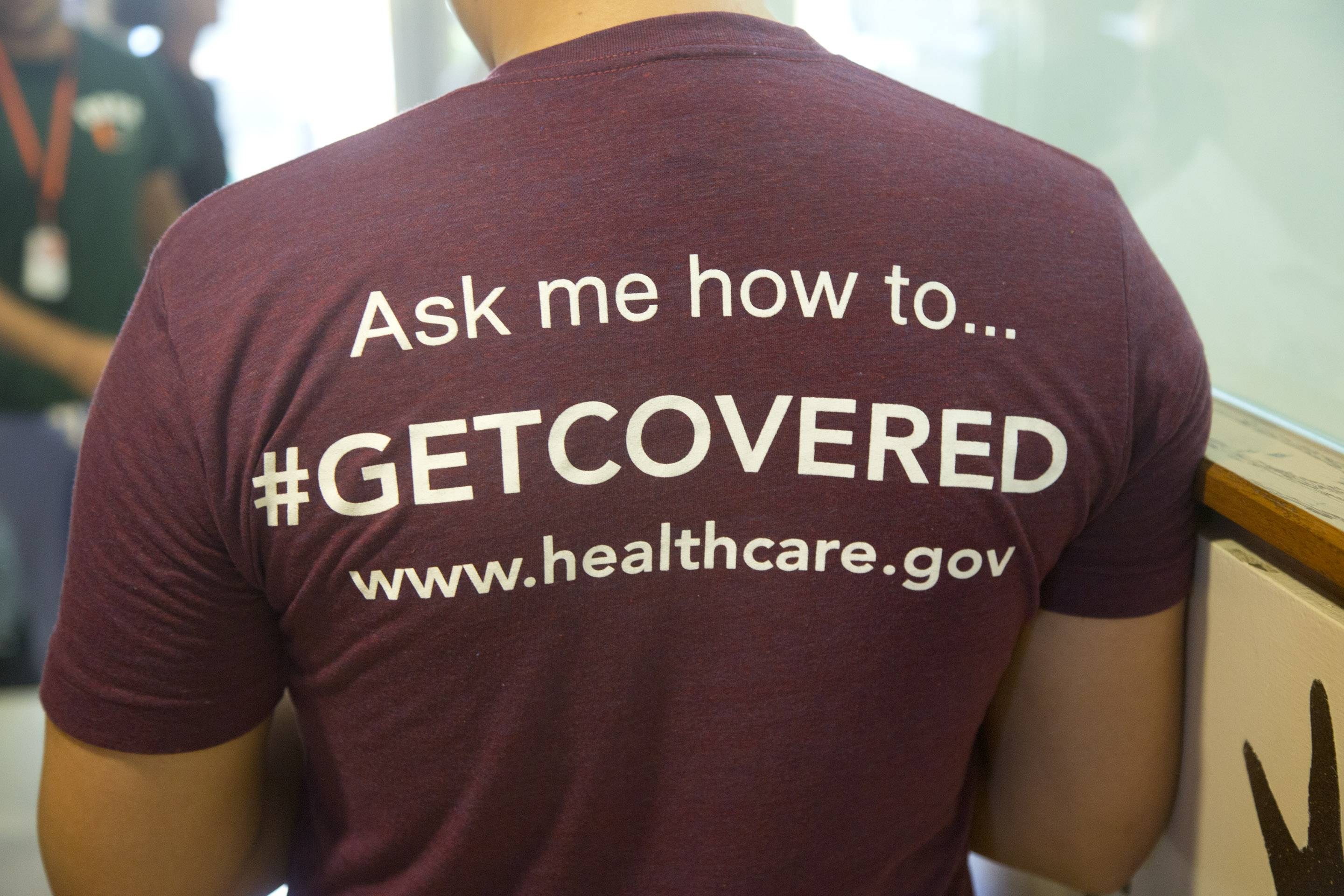 A volunteer health care worker recruits people to sign up for the new health care programs. As federal health officials are aggressively courting young adults to sign up for health insurance with celebrity endorsement and social media campaigns, they are also getting significant help from the very demographic they're targeting.