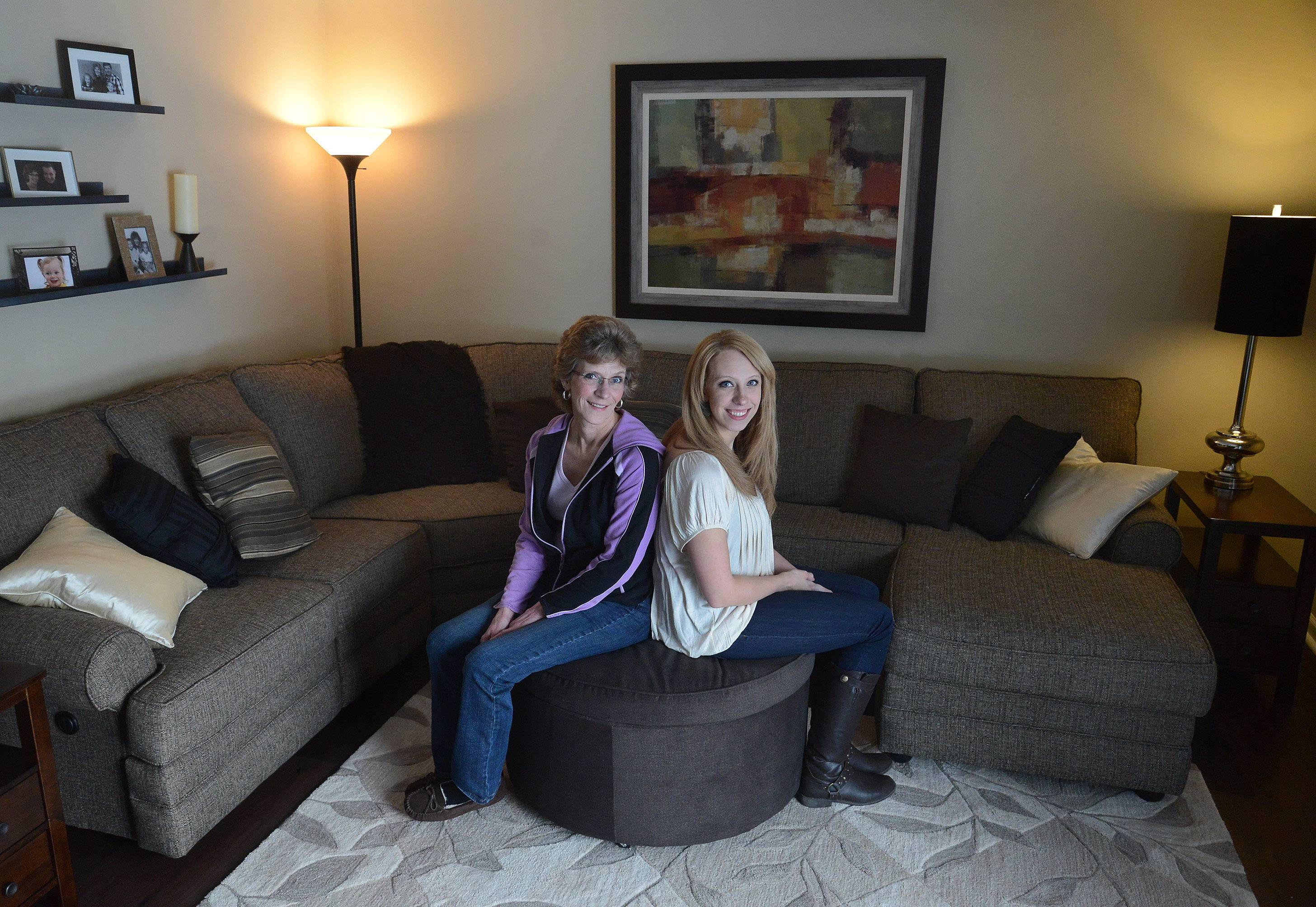 Terry, left, and Kelsey Burck enjoy their recently completed Palatine living room, courtest of the Room for Living makeover contest.