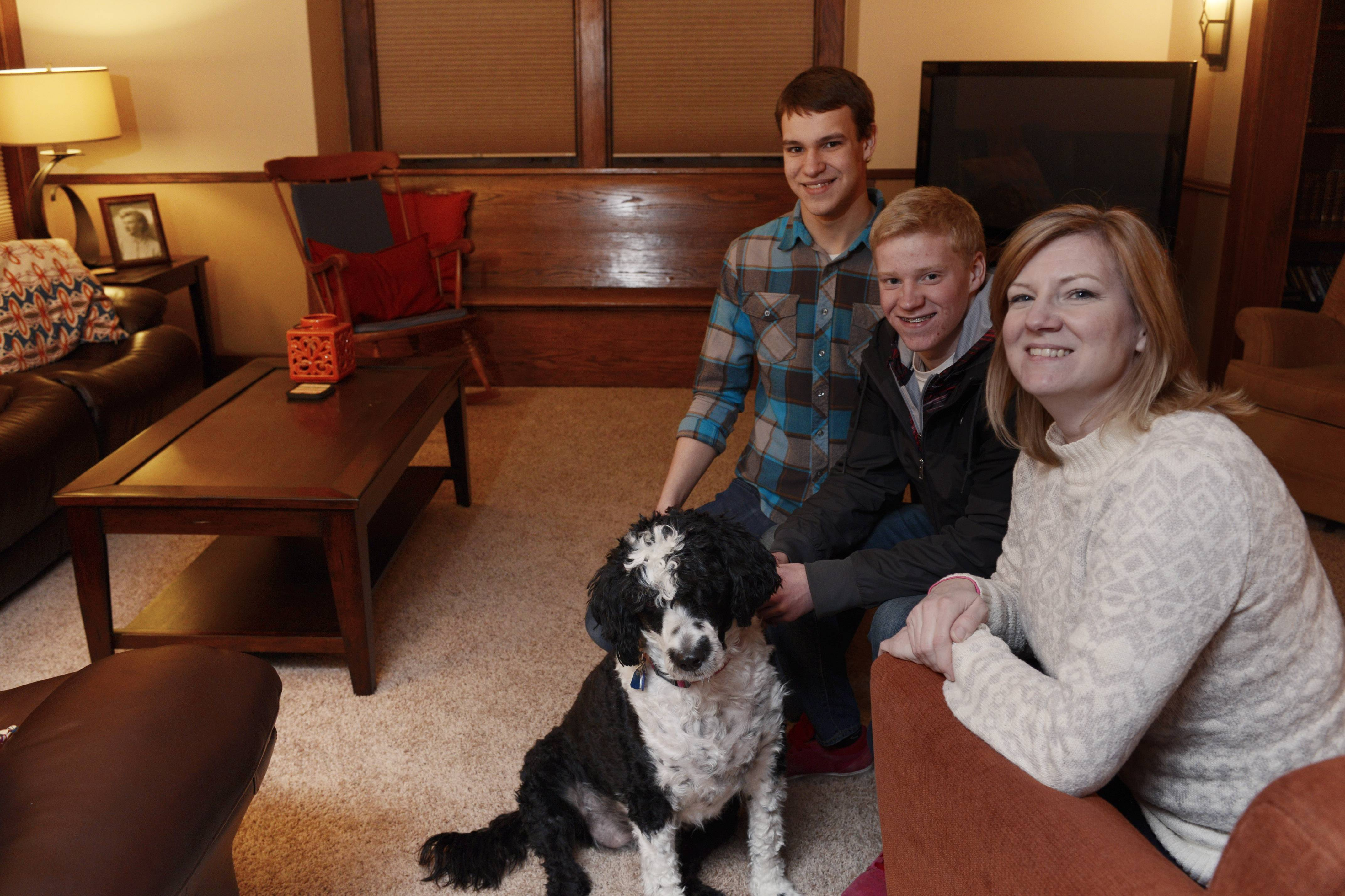 "Contest winner Sharon Brown is seated in her ""new"" living room in her Palatine home with two of her four children, Ethan, left, and Graham, and the family dog, Penny."