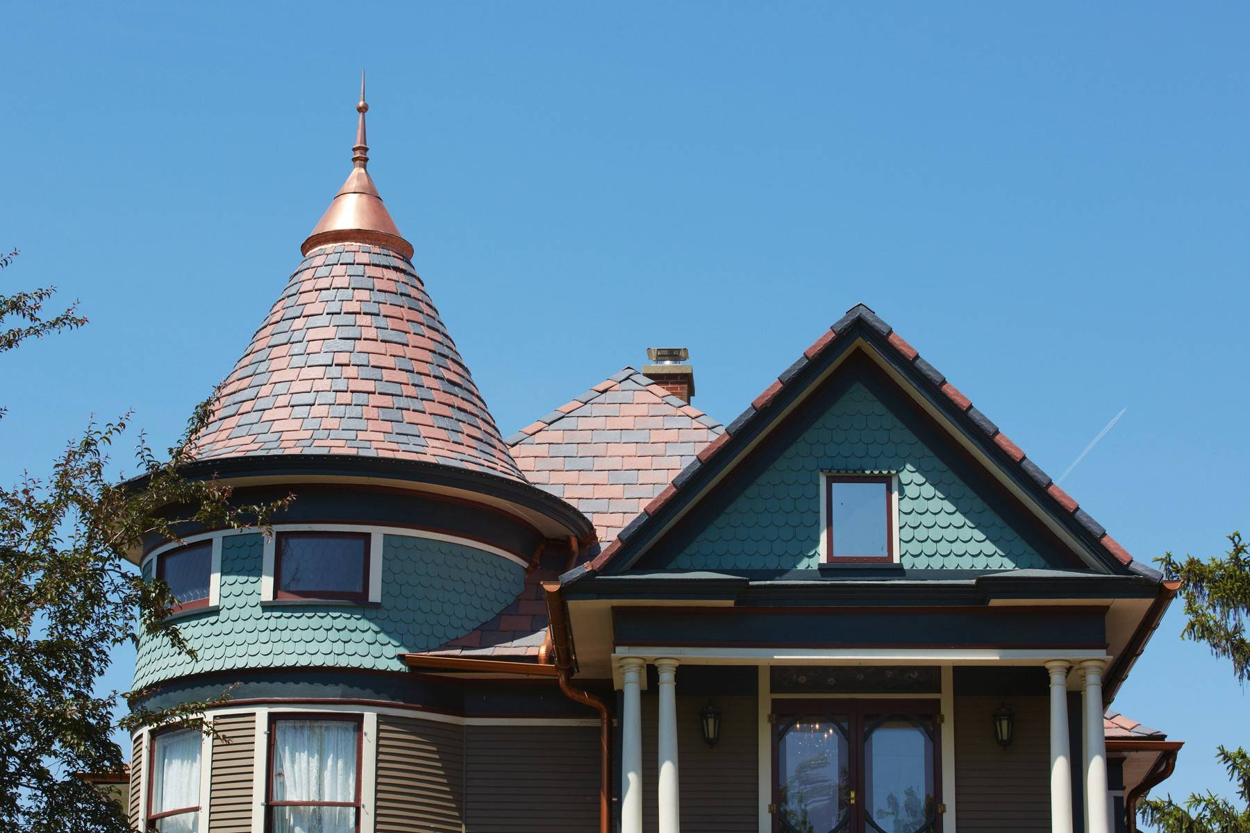 This red and gray roof replaced a storm-damaged black one at Carol and Ray Knoff's home in Vinton, Iowa. The colors are more typical of the original roofs on Victorian homes.