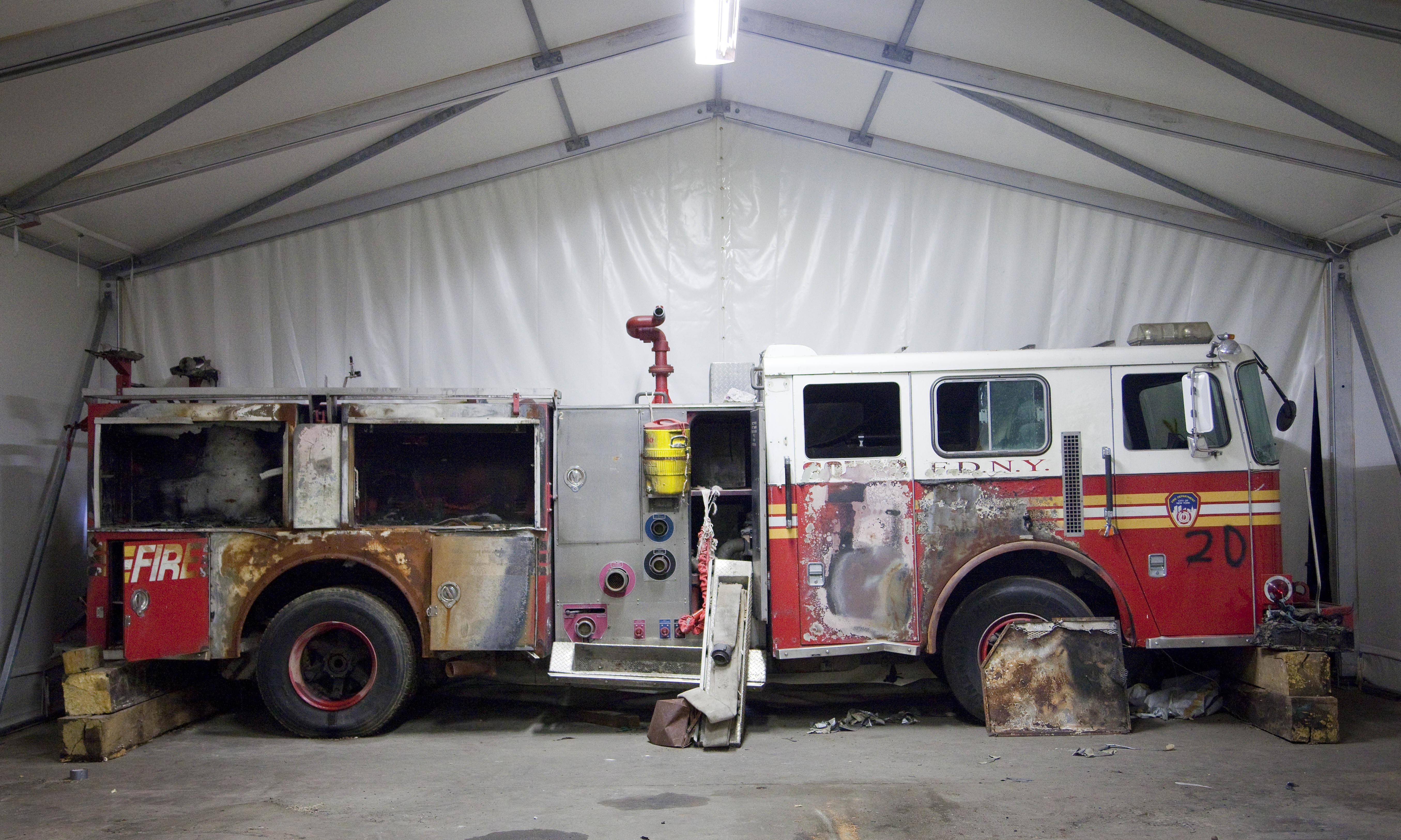A damaged New York Fire Department truck is part of the collection of artifacts for the National September 11 Museum. The long-awaited museum dedicated to the victims of the Sept. 11 terror attacks will open to the public at the World Trade Center site on May 21, officials announced Monday, March 24.