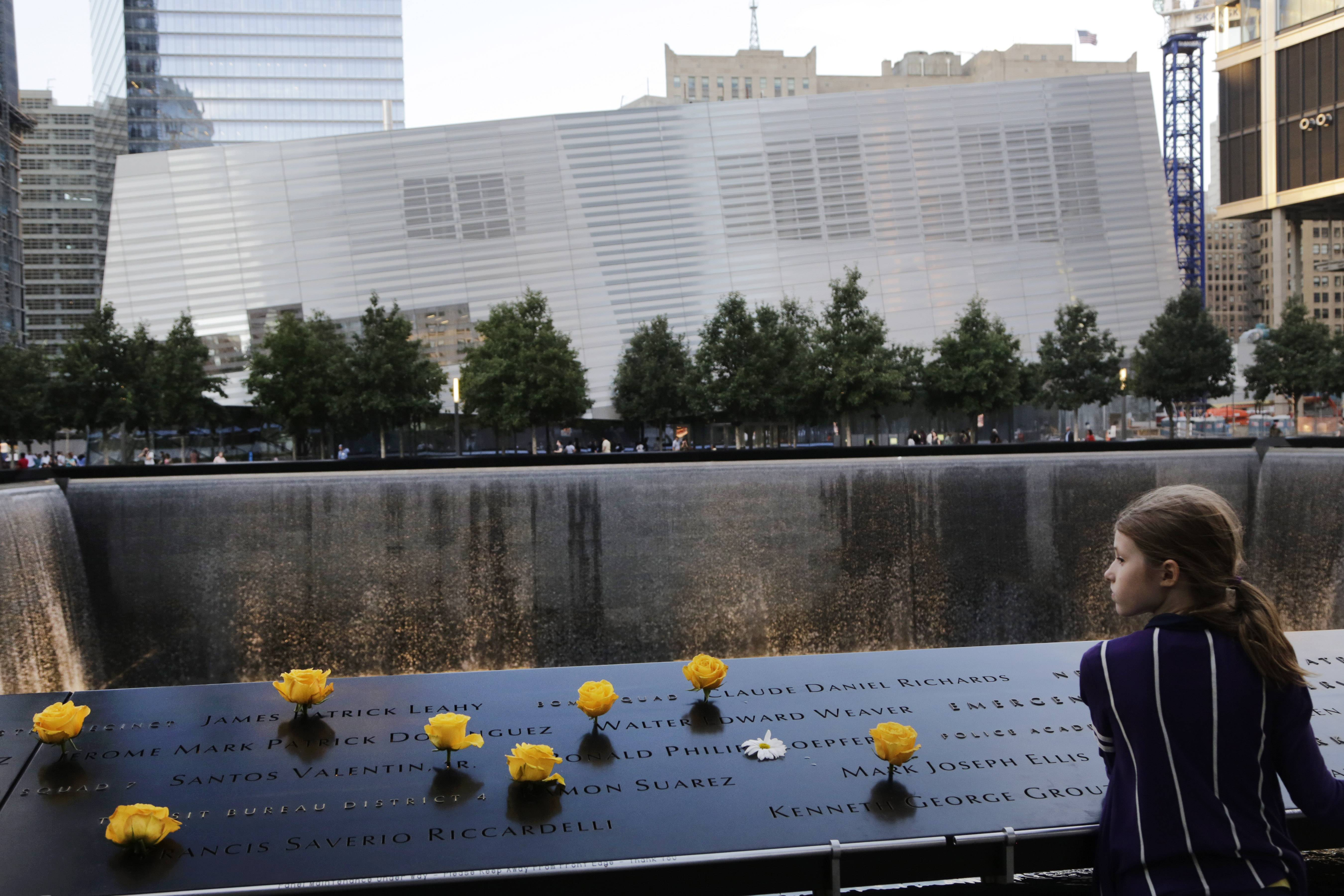 Charlotte Newman, 8, visits the National September 11 Memorial and Museum last year. The long-awaited museum, in the background, will open to the public on May 21.