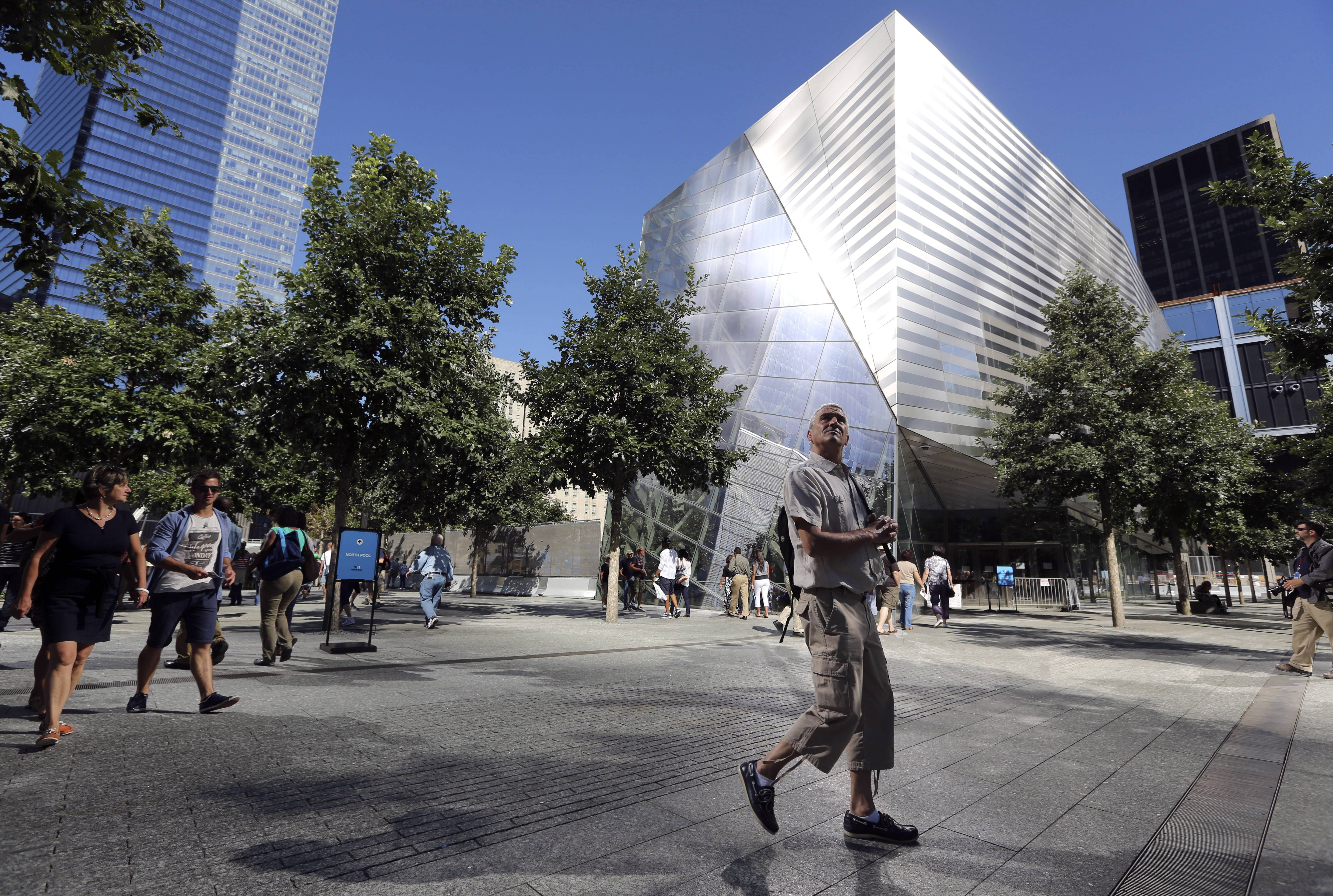 A visitor to the National September 11 Memorial and Museum takes in the sight as he walks past the museum in New York.