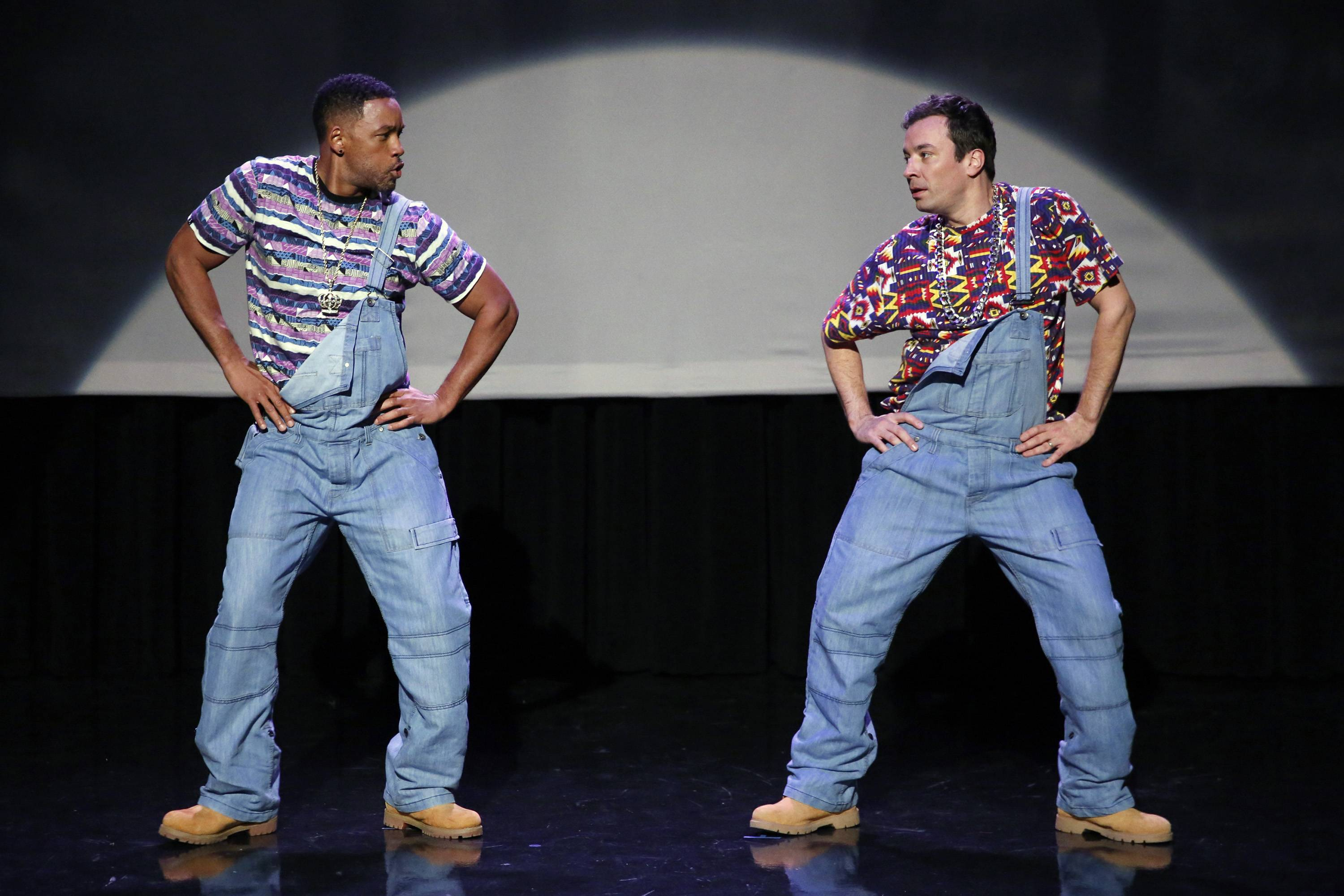 "Will Smith, left, and host Jimmy Fallon act out the evolution of hip-hop dancing on the premiere of ""The Tonight Show Starring Jimmy Fallon"" in New York. The clip has been viewed nearly 13 million times on YouTube."
