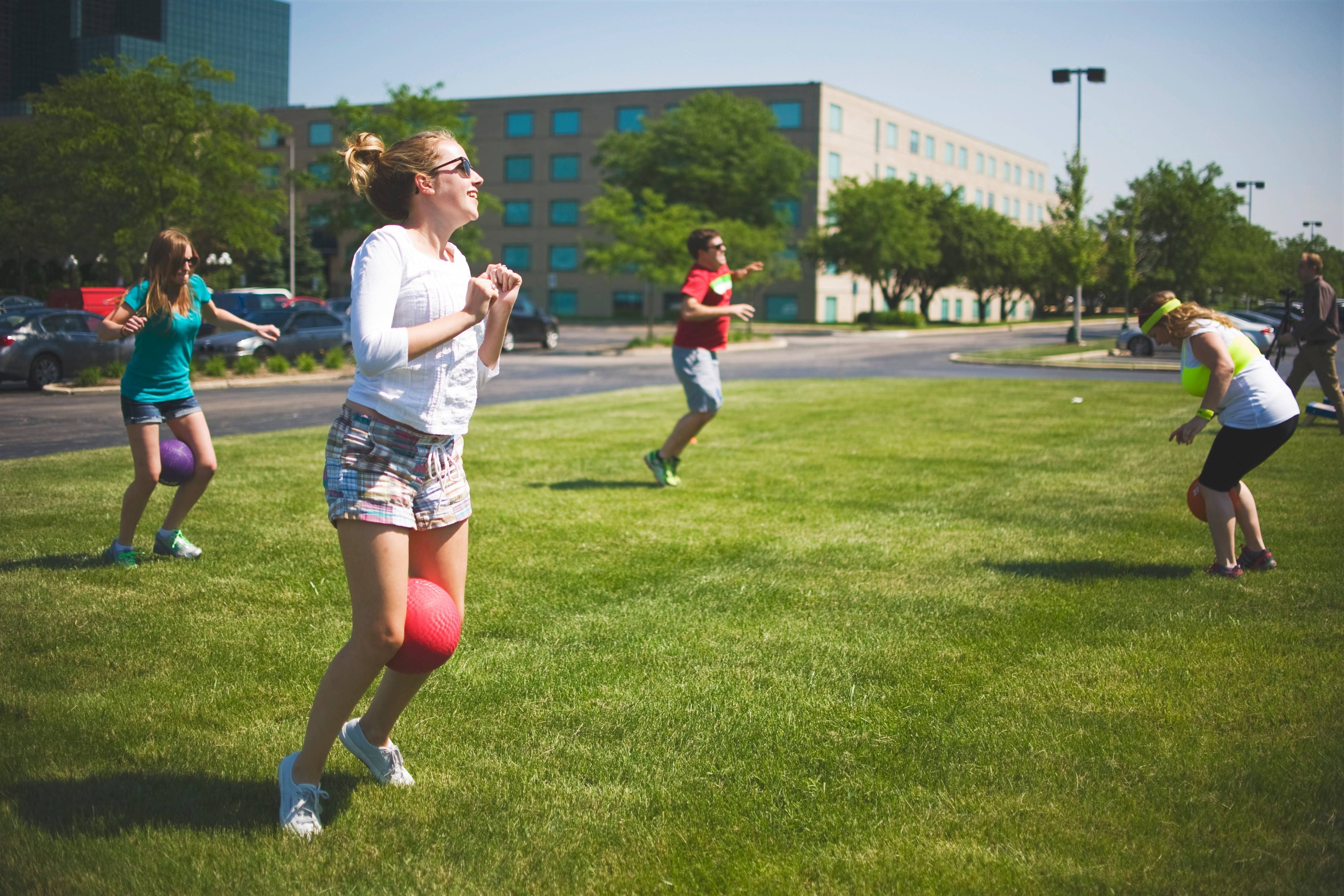 Sarah Bump, marketing events coordinator, and other Assurance employees enjoy a few, fun bursts of aerobic exertion outside of their cubicles in Schaumburg.