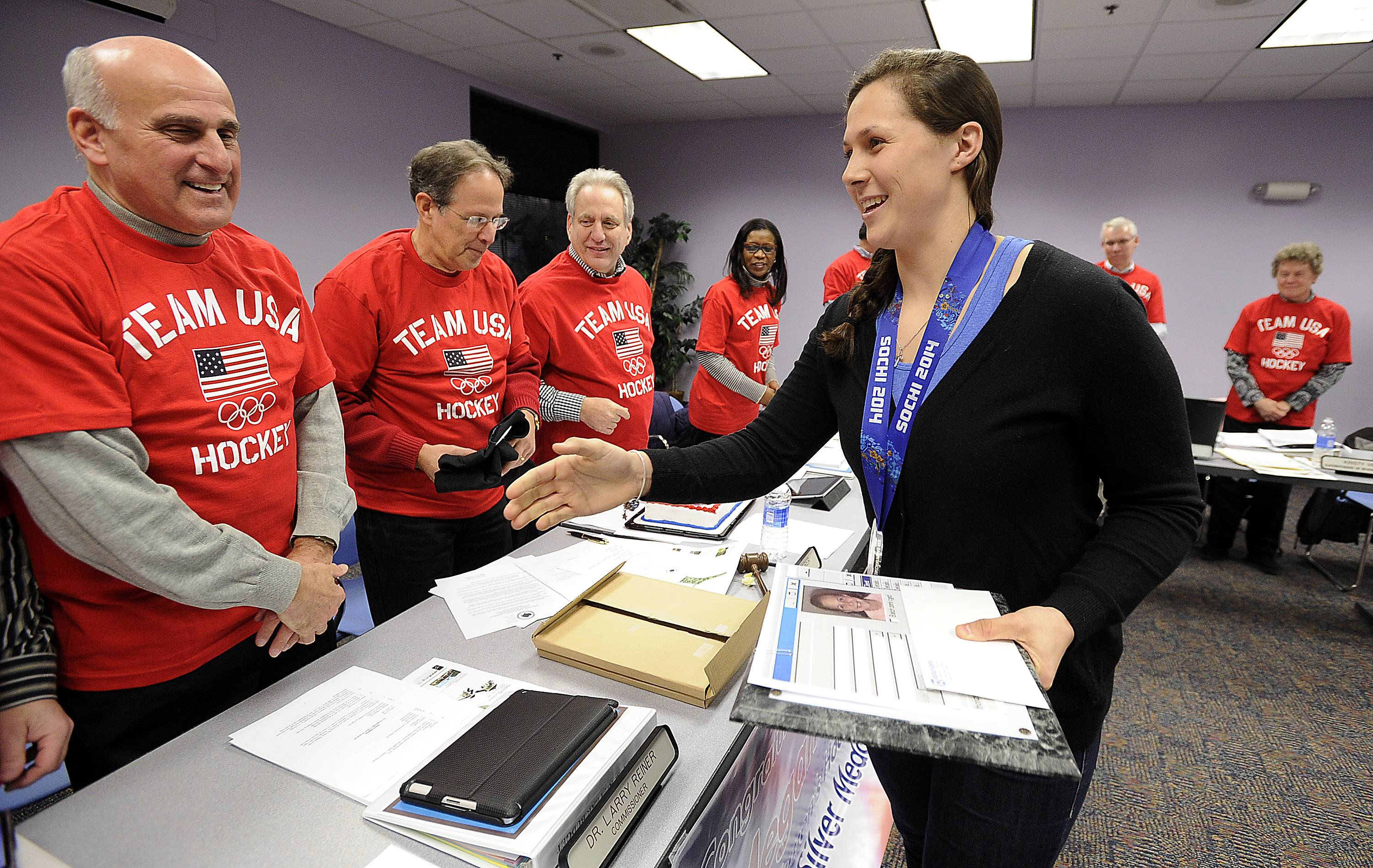 Buffalo Grove resident Megan Bozek is greeted by the members of the Buffalo Grove Park District Monday where she proudly displayed her silver medal she won on the Winter Olympics hockey team in Sochi. She was honored for her achievements.