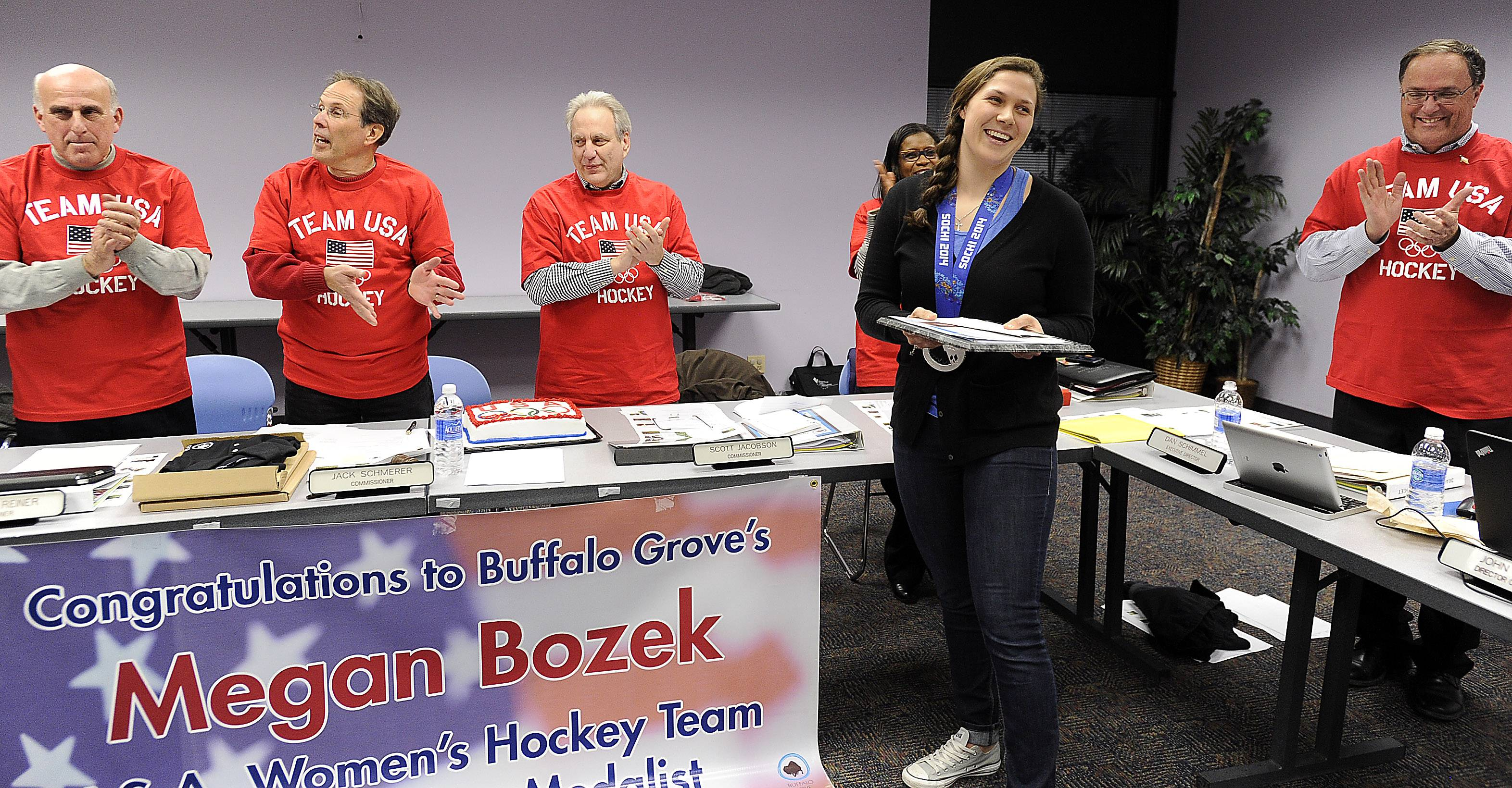 Buffalo Grove resident Megan Bozek is greeted by the members of the Buffalo Grove Park District where she proudly displayed her silver medal she won on the Winter Olympics hockey team in Sochi. She was honored for her achievements.