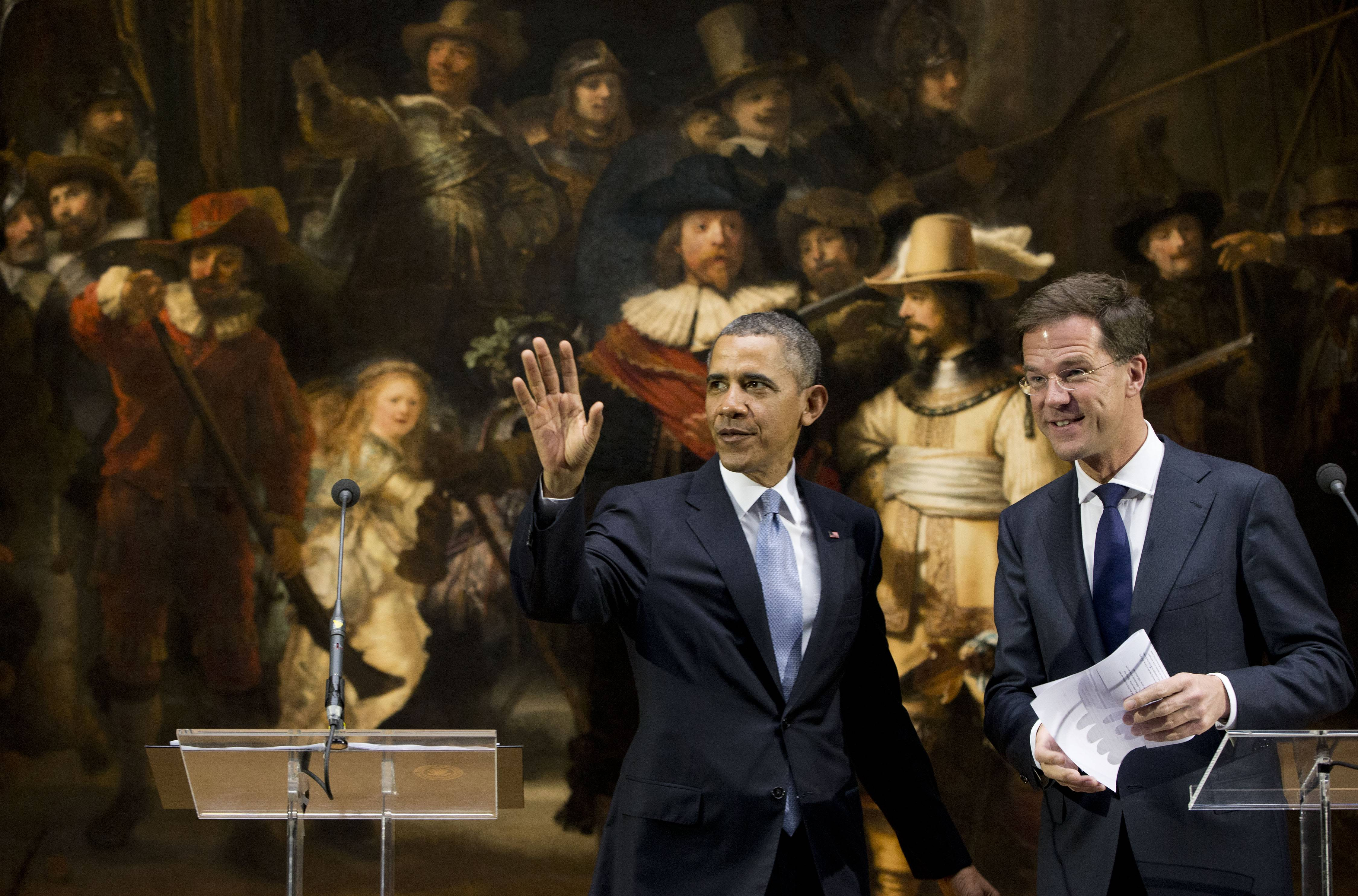 "U.S. President Barack Obama and Prime Minister of the Netherlands Mark Rutte leave after their joint statement in front of Rembrandt's ""The Nightwatch"" at Rijksmuseum in Amsterdam. Obama is attending the Nuclear Security Summit in The Hague, which will form the backdrop for an emergency meeting of Group of Seven leaders on Russia's annexation of Crimea."