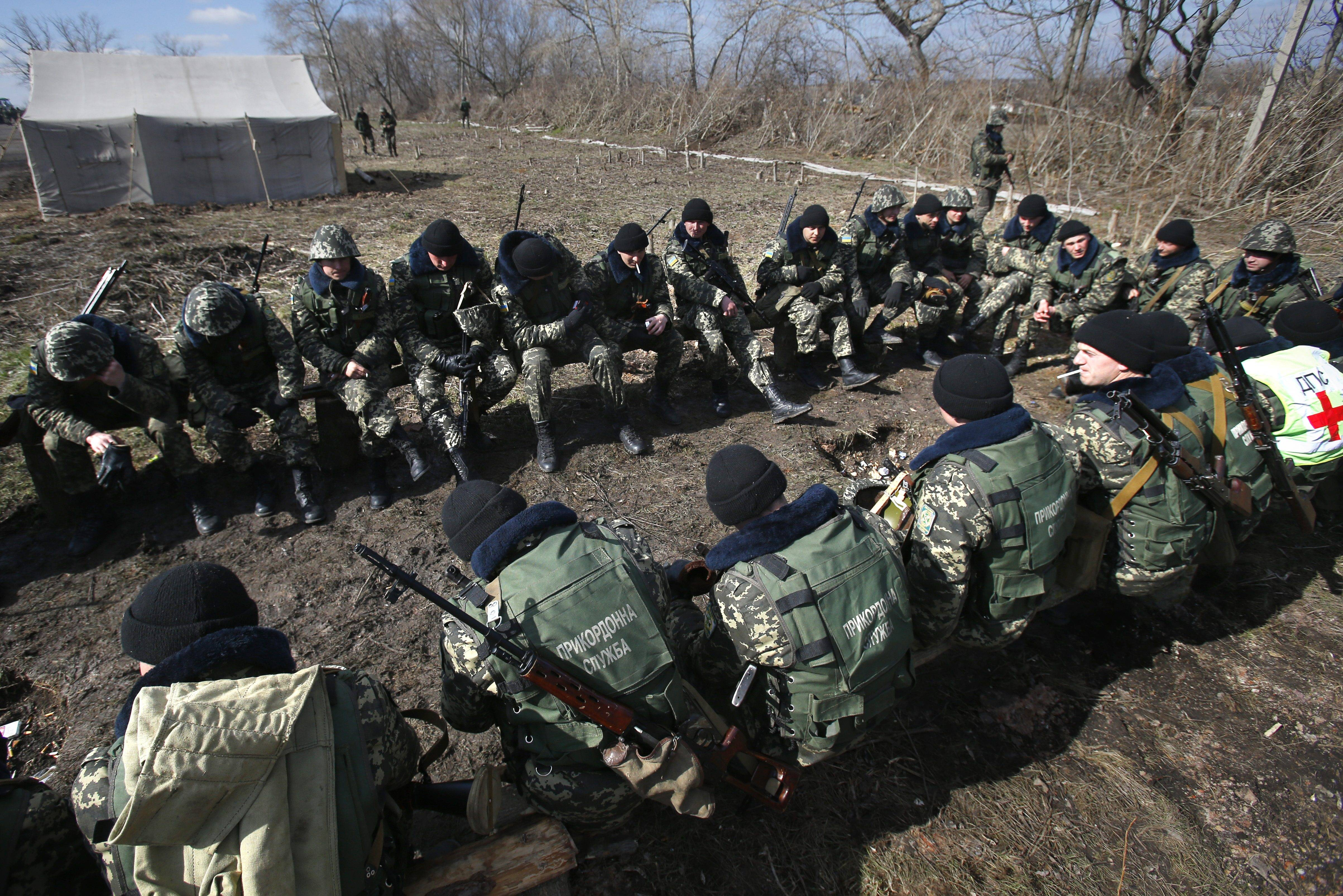 Ukrainian border guards take a break Friday during a training session at a military camp in the village of Alekseyevka on the Ukrainian-Russian border. Russian President Vladimir Putin signed bills on Friday making Crimea part of Russia, completing the annexation from Ukraine.