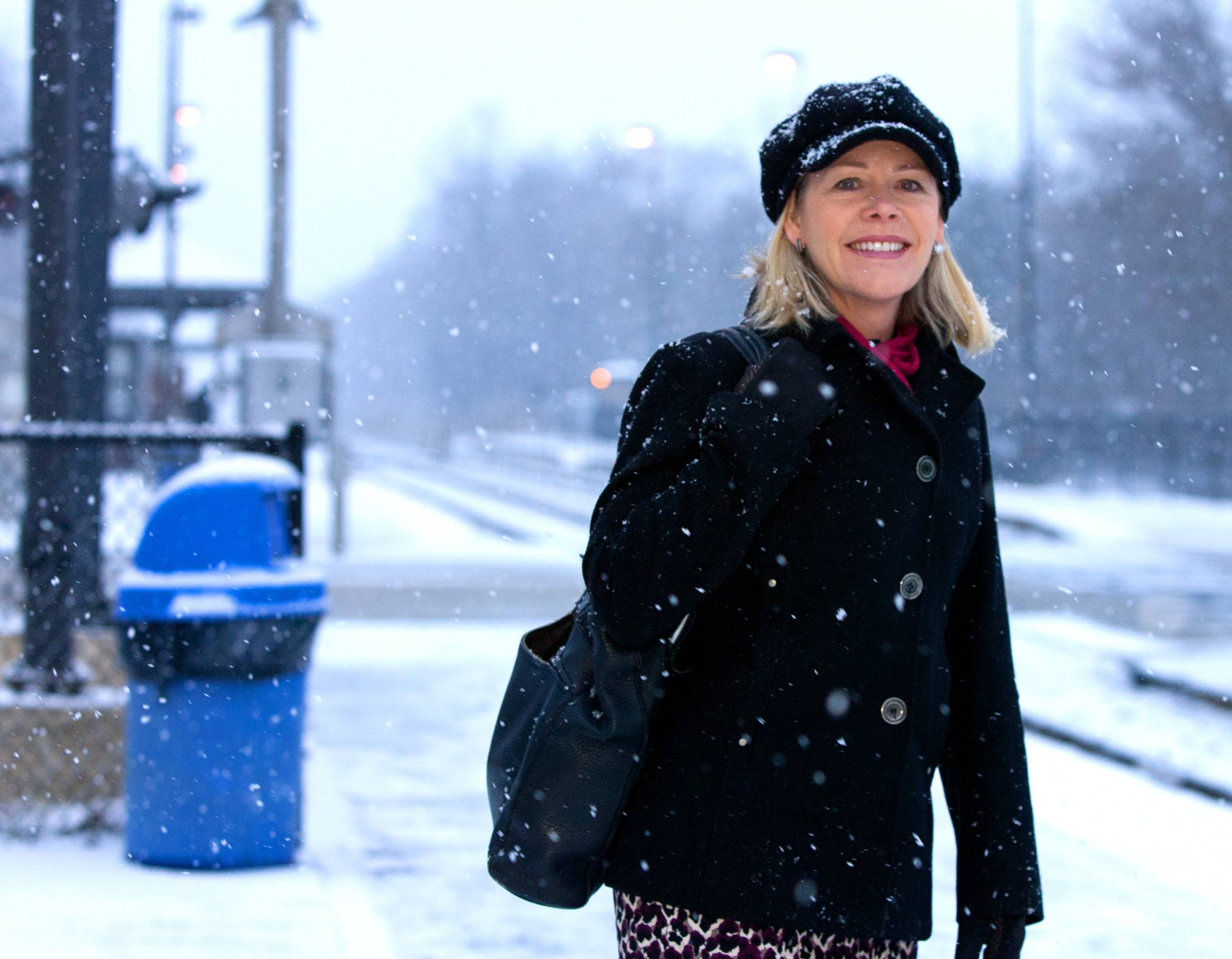 Interim RTA Executive Director Leanne Redden waits to board a Metra train to work at the Medinah station.