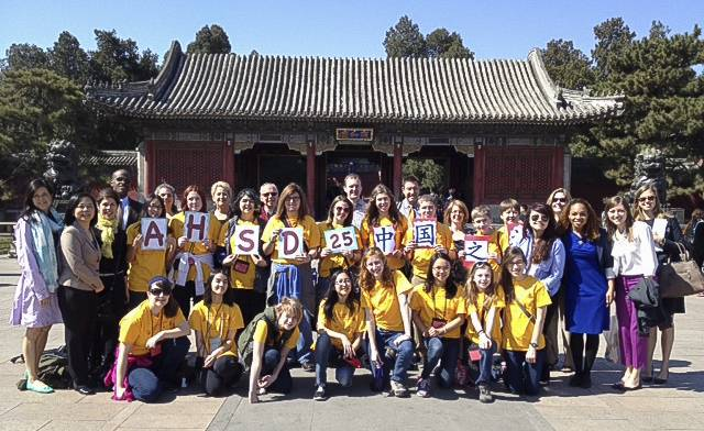 This group picture of all 29 Arlington Heights students visiting China includes kids from Thomas and South Middle Schools. The picture was taken at the East Gate of the Summer Palace where the students were greeted by White House staffers, right.