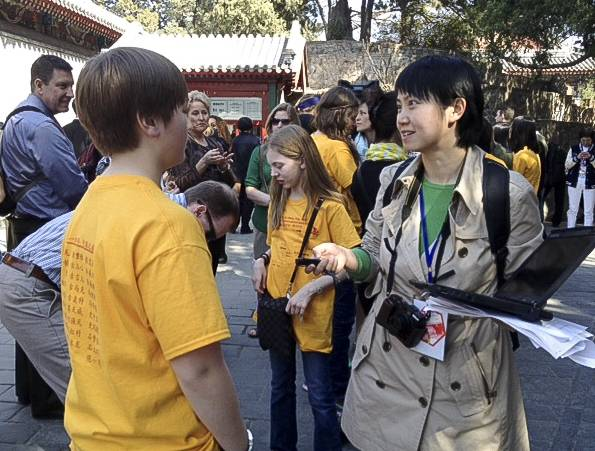 A Chinese reporter interviews Arlington Heights middle-schooler Nathan Van Gelderen.