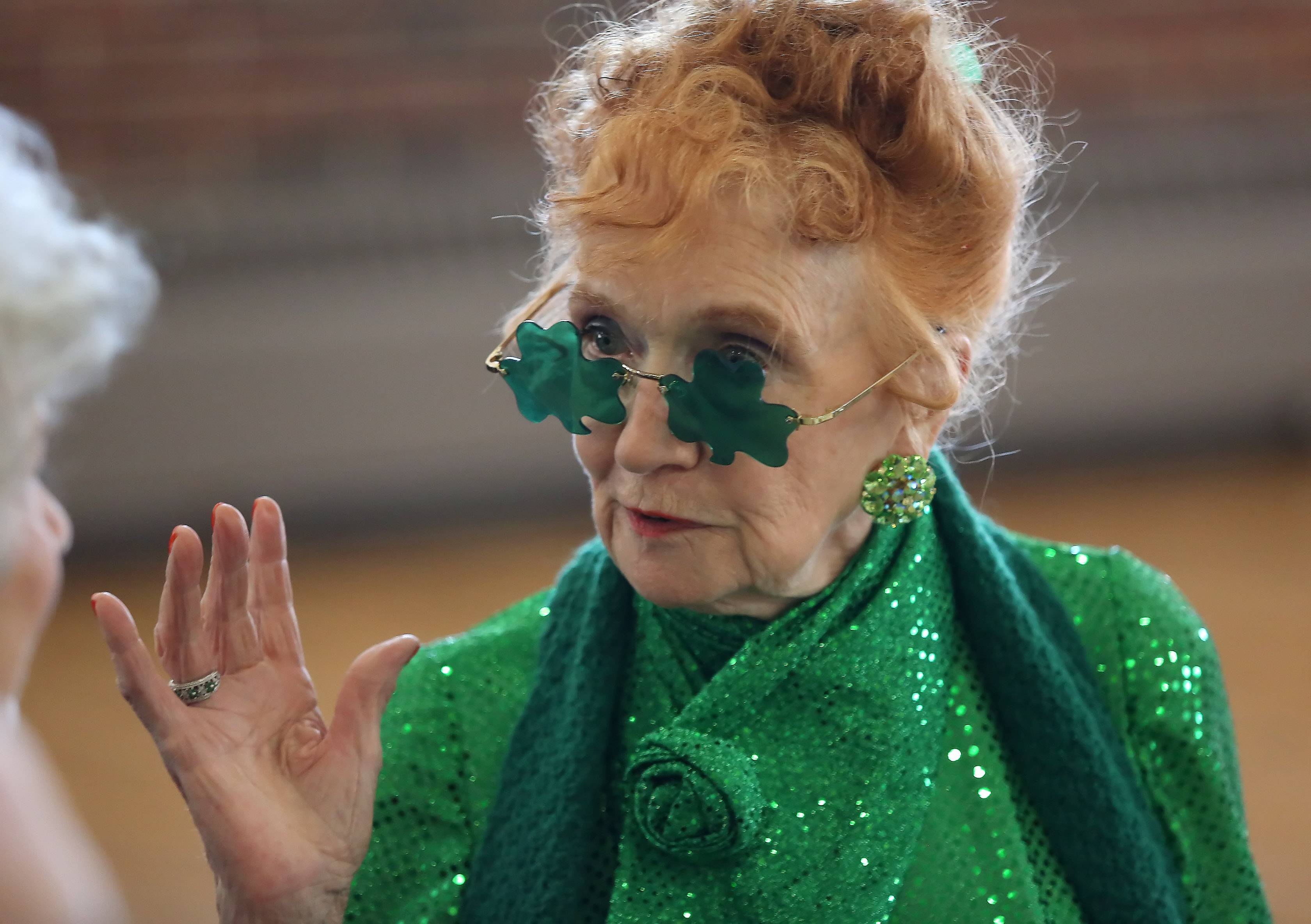 Patricia Stober of Grayslake dresses all in green for the St. Patrick's Day Party Monday by the Libertyville Senior Center. The event featured a traditional Irish lunch of corned beef and cabbage and dancing to The Ron Barron Trio.